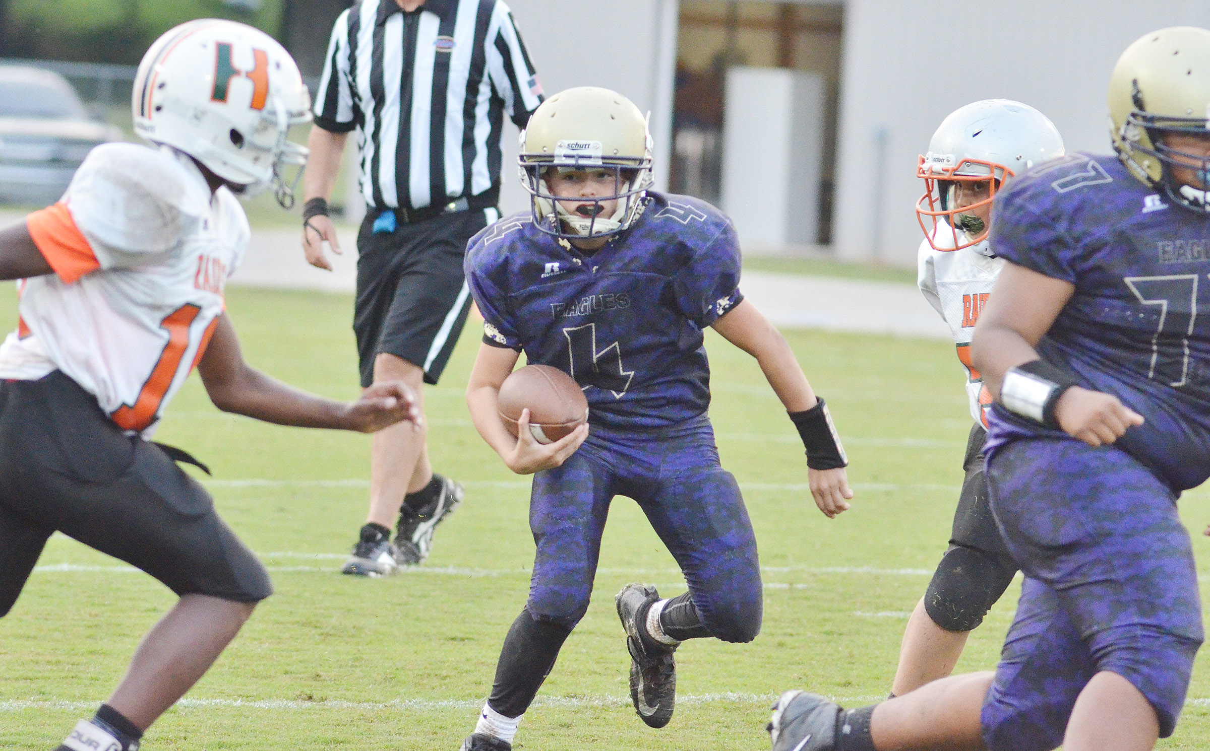 CMS seventh-grader Konner Forbis runs the ball.