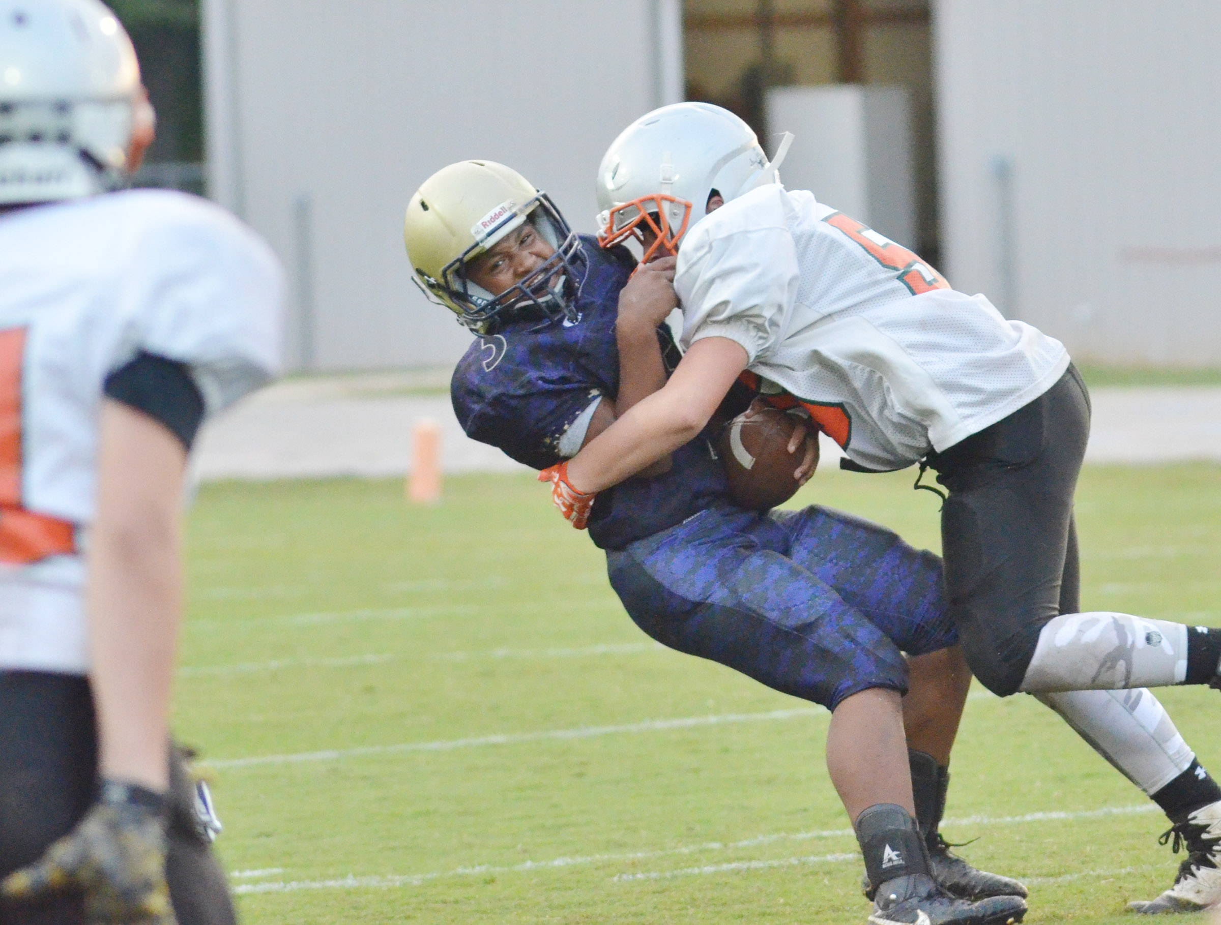 CMS seventh-grader Deondre Weathers is tackled.
