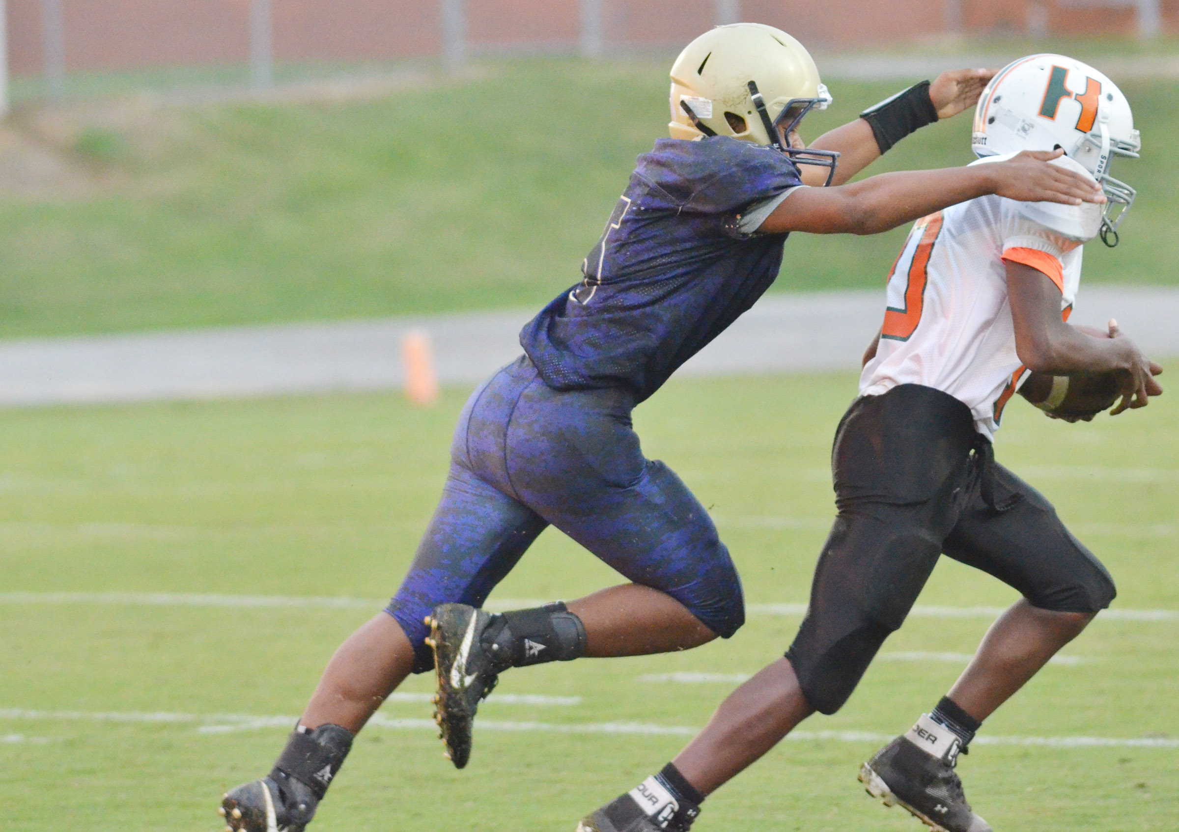 CMS seventh-grader Deondre Weathers tackles.