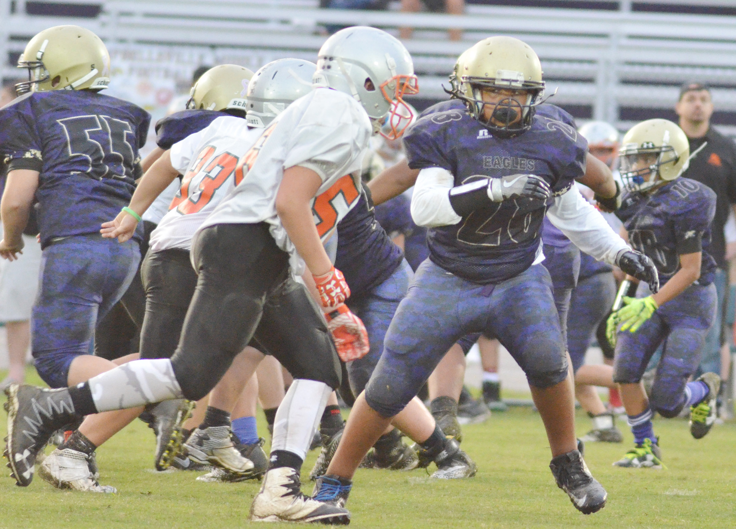 CMS seventh-grader Keondre Weathers tackles.