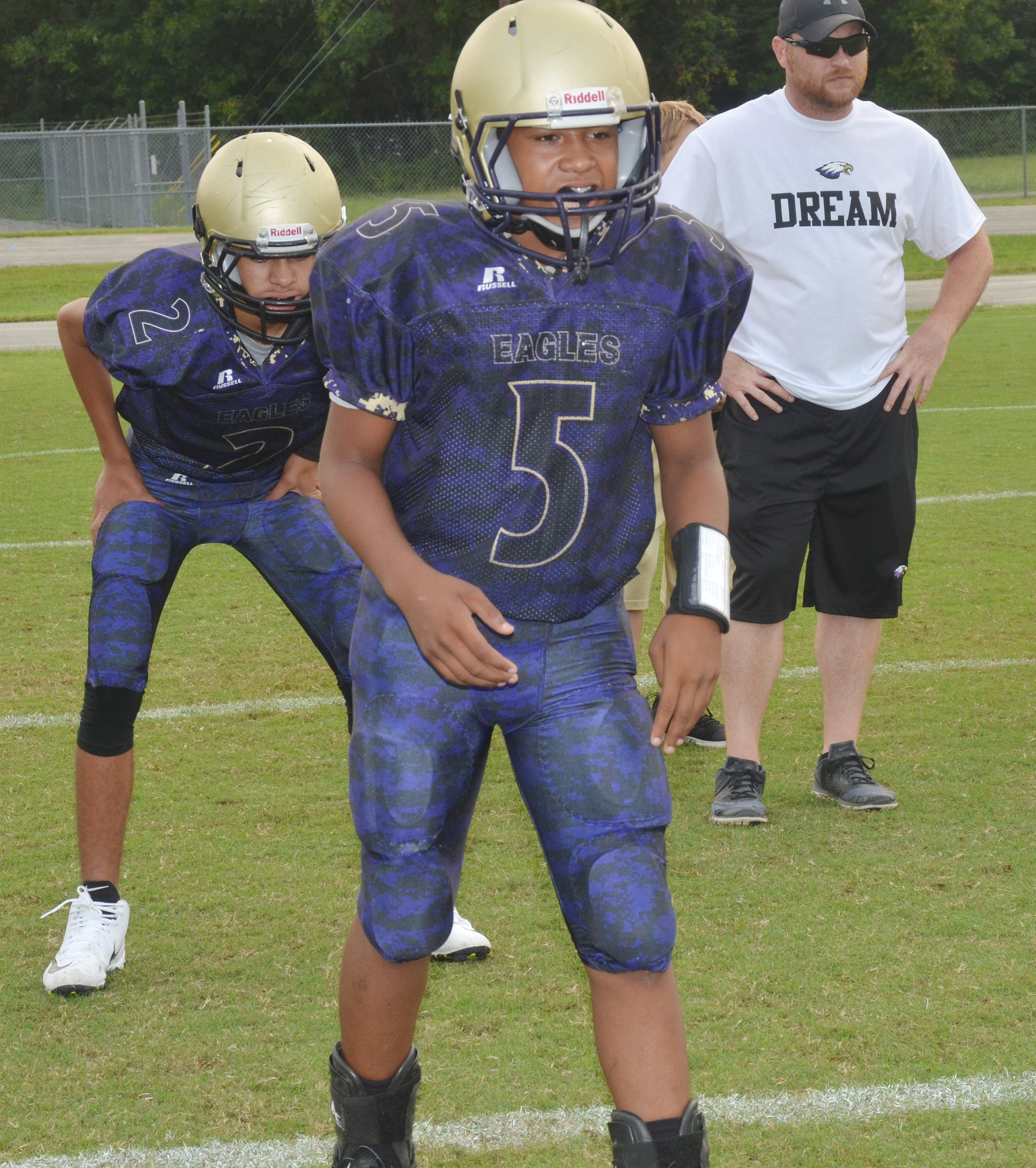 CMS seventh-grader Deondre Weathers practices a play before the game.