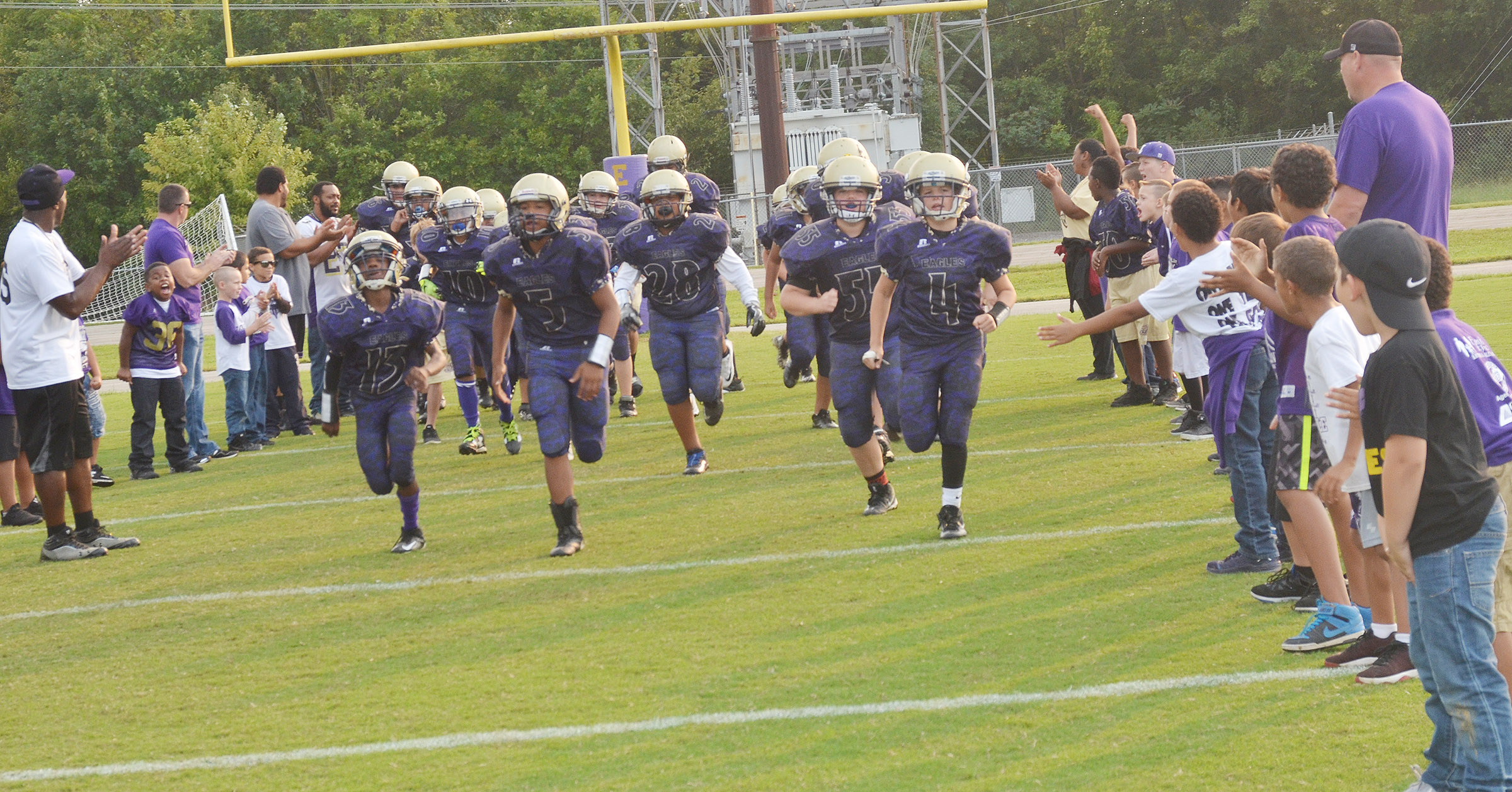 CMS football players take the field.
