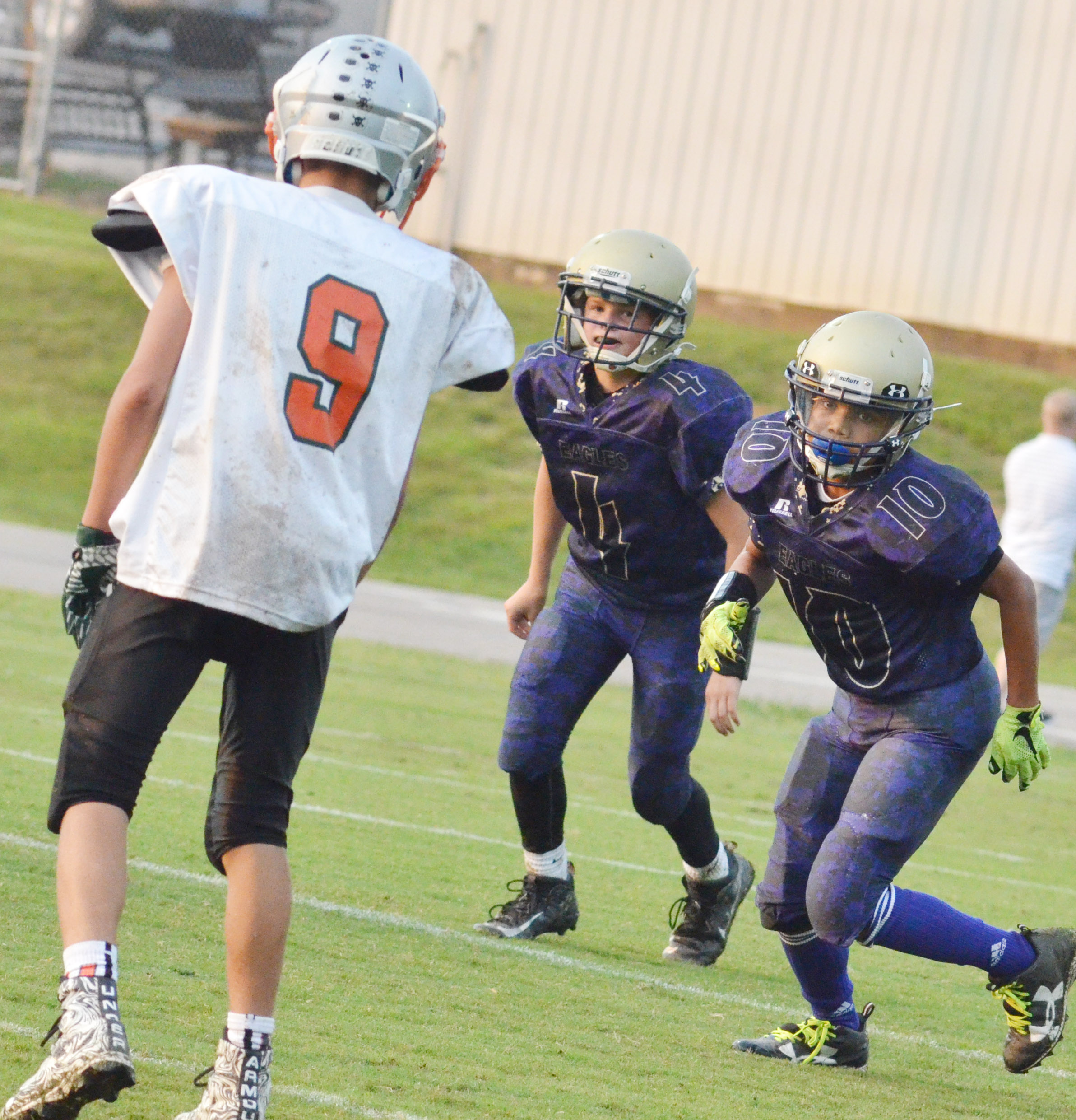 CMS seventh-grader Konner Forbis, at left, and sixth-grader Tashaun Hart run.