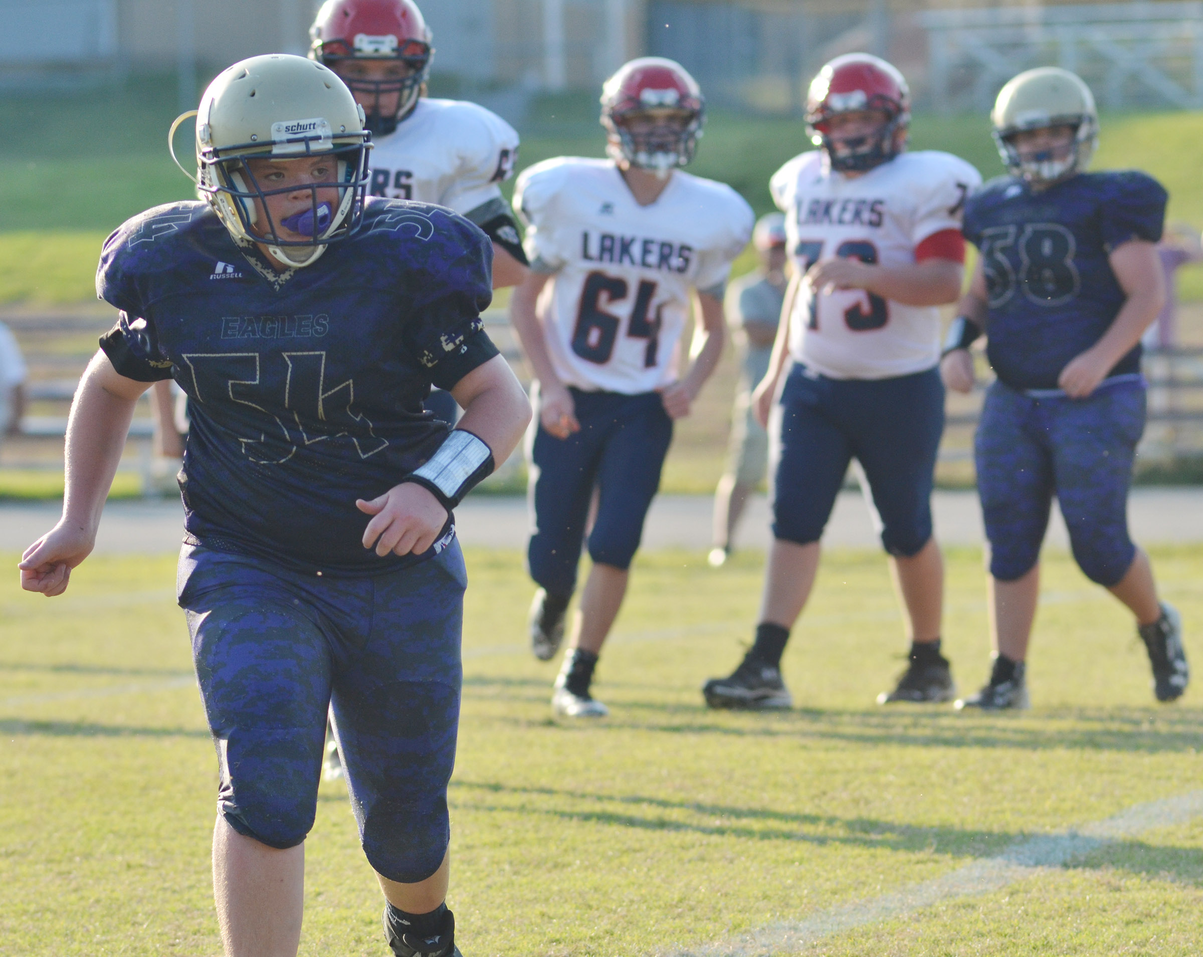 CMS seventh-grader Hayden Jones runs to tackle.