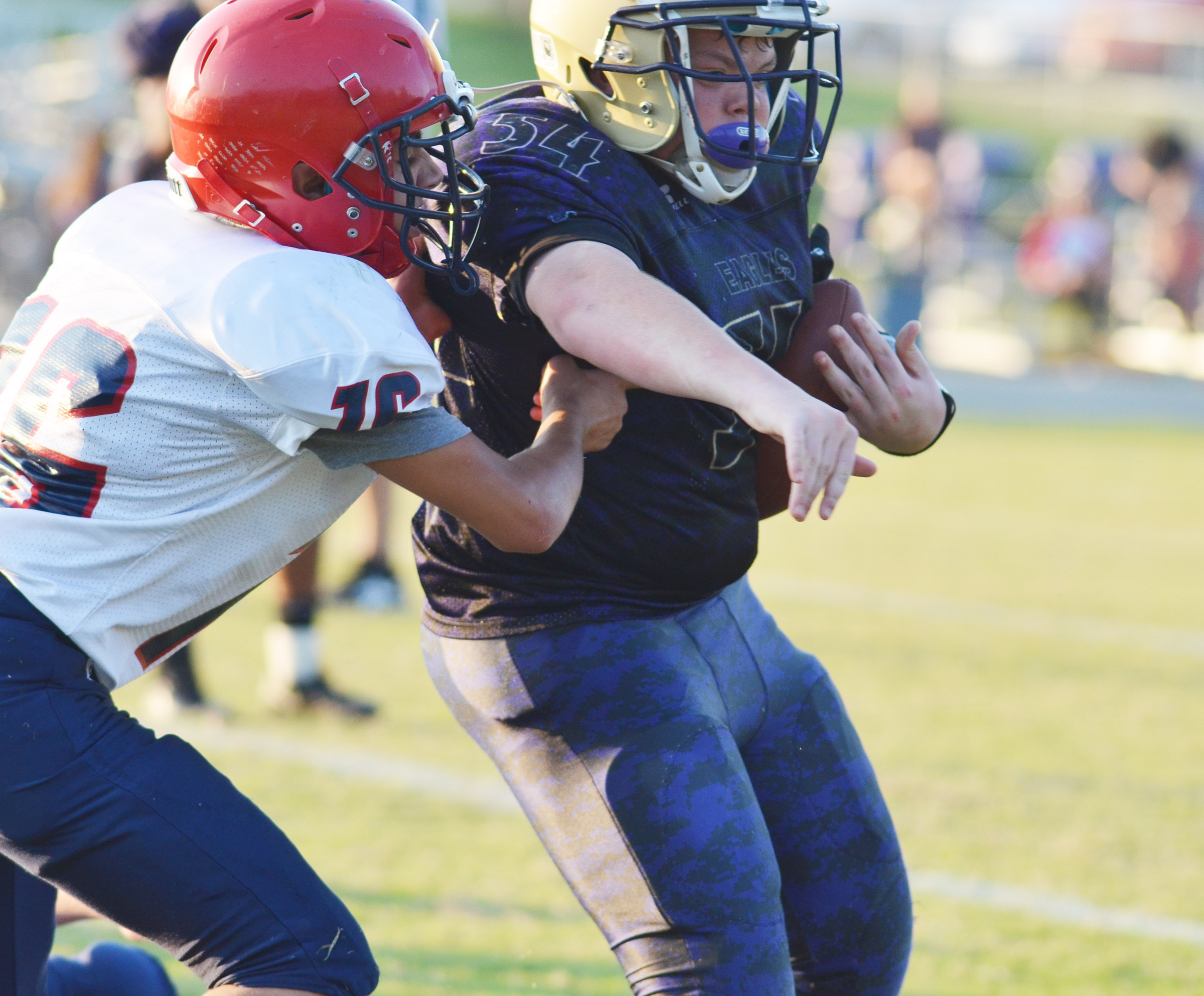 CMS seventh-grader Hayden Jones runs the ball.