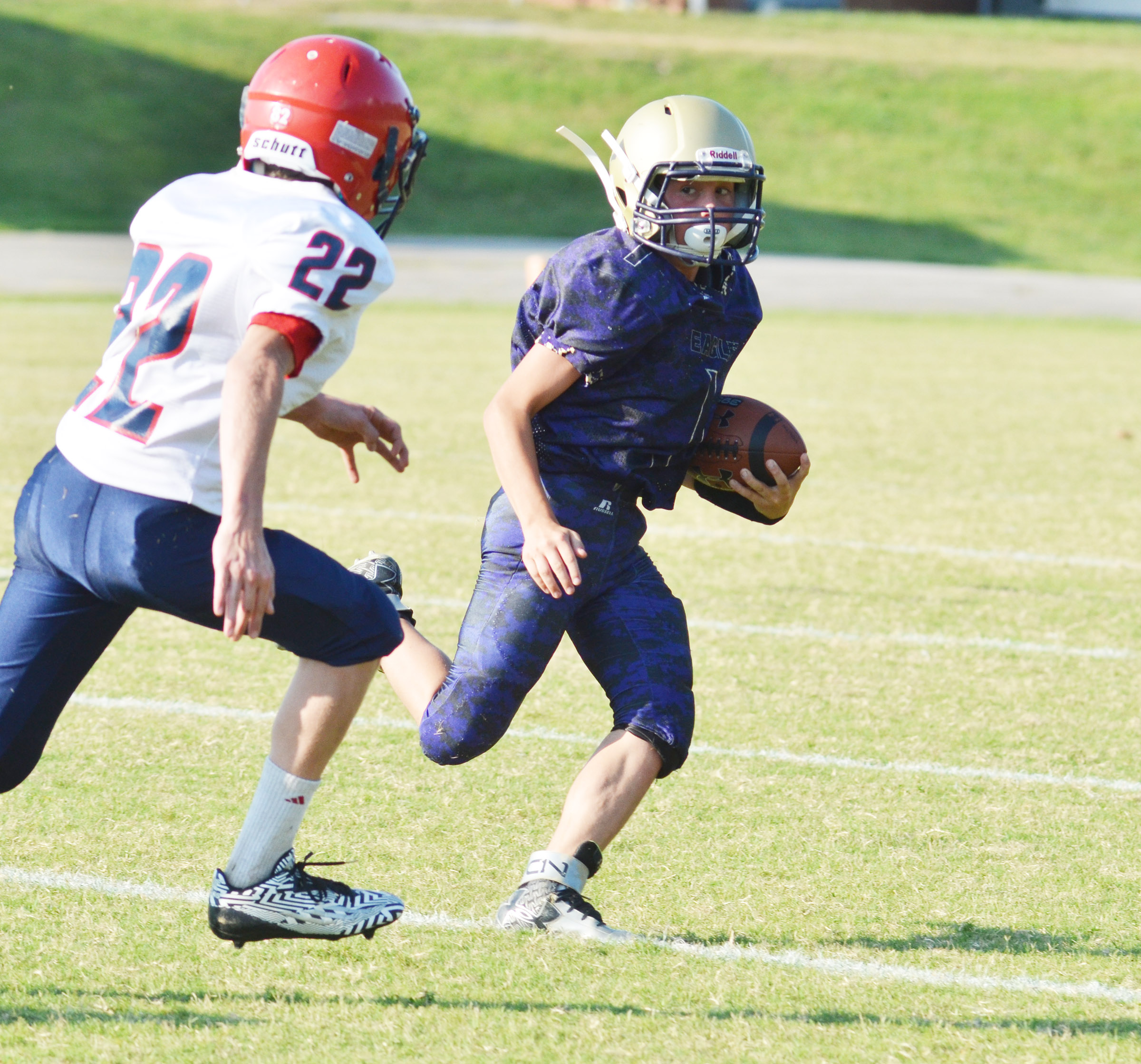 CMS eighth-grader Dakota Harris runs the ball.
