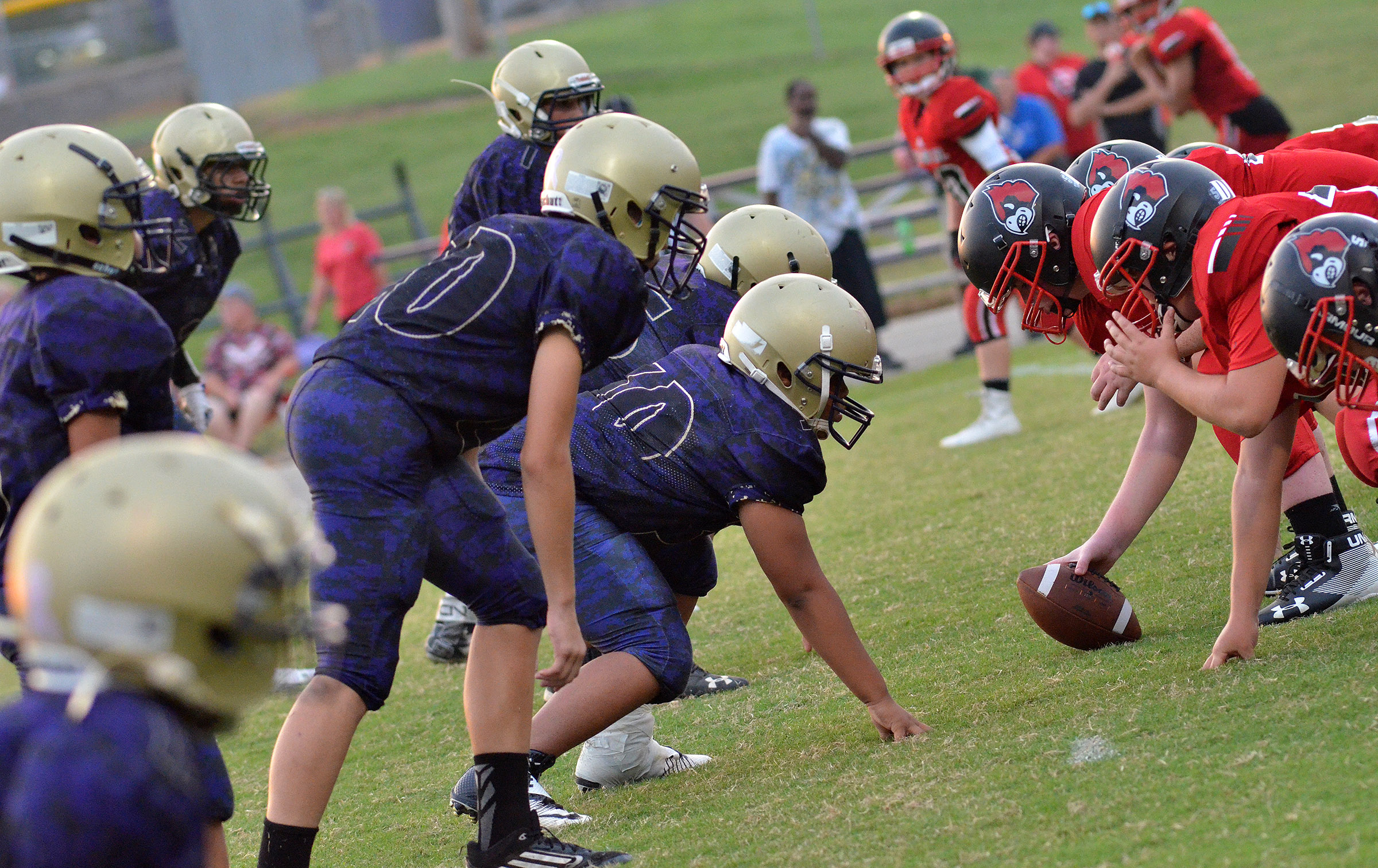 CMS defensive line players get ready to tackle.
