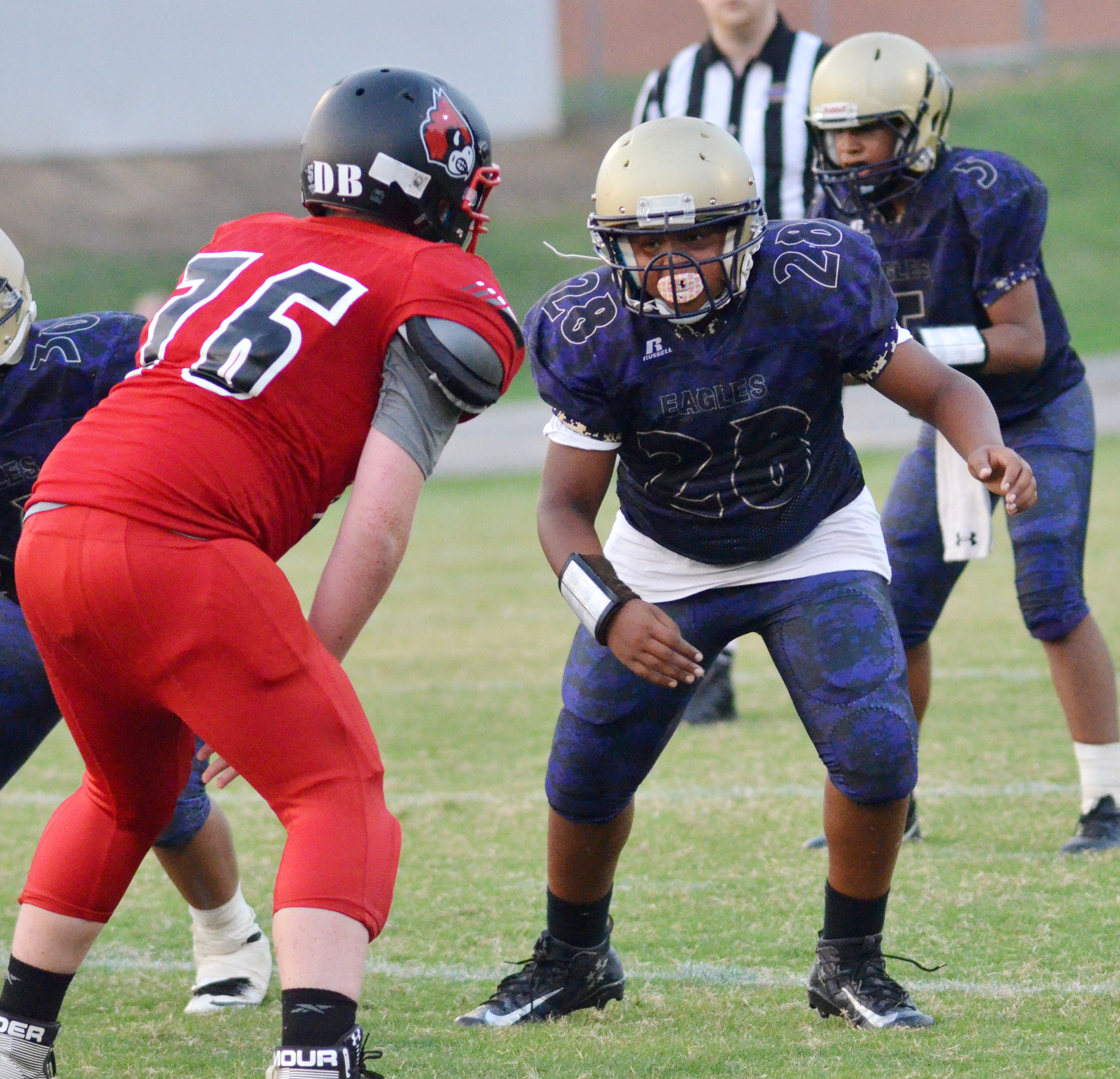 CMS seventh-grader Keondre Weathers blocks.
