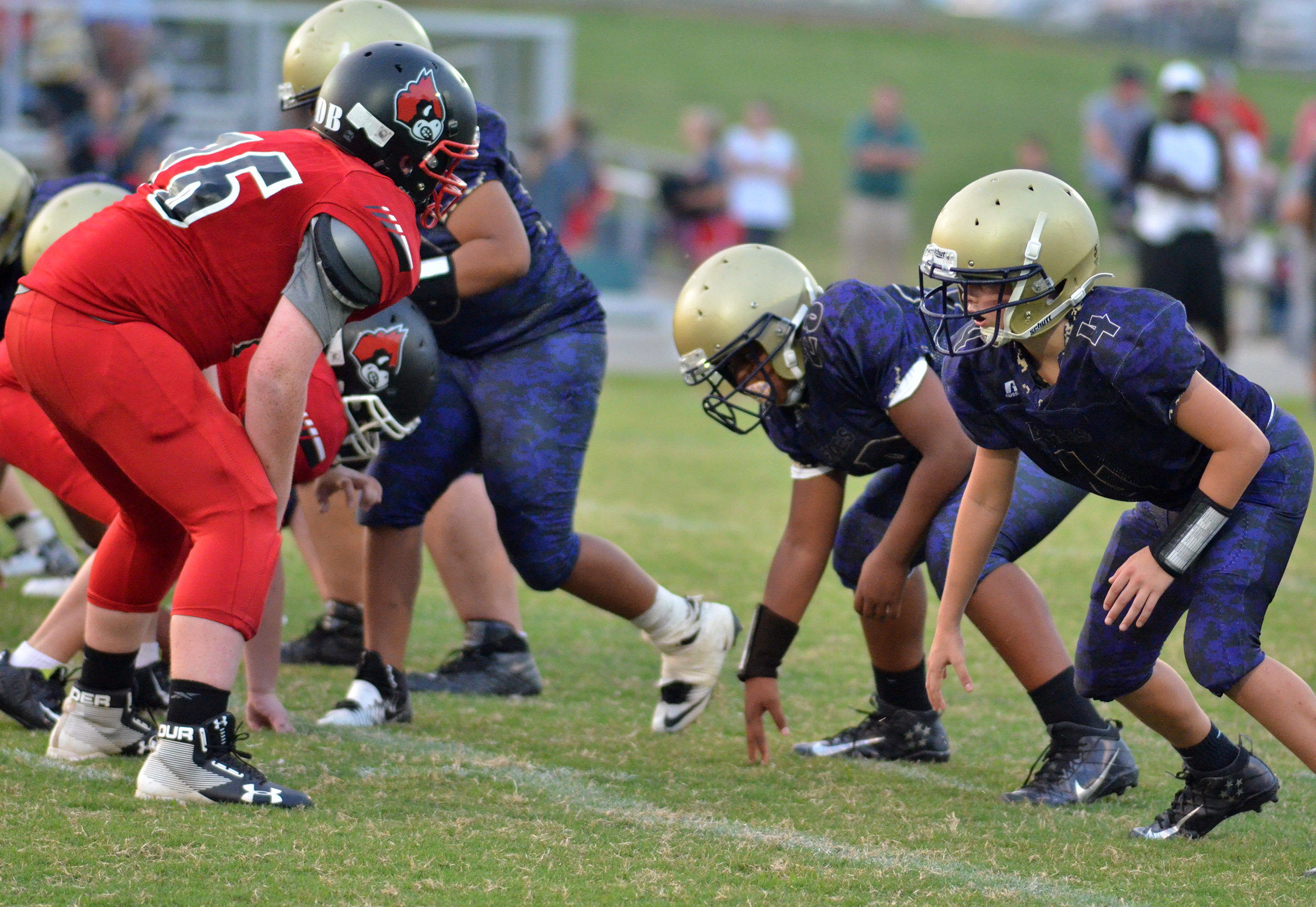 CMS seventh-grader Konner Forbis, at right, gets ready for the snap.