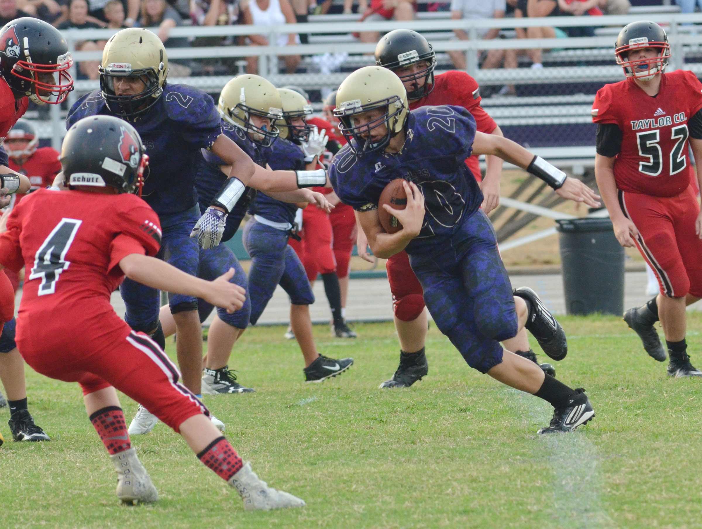 CMS seventh-grader Damon Johnson runs the ball.