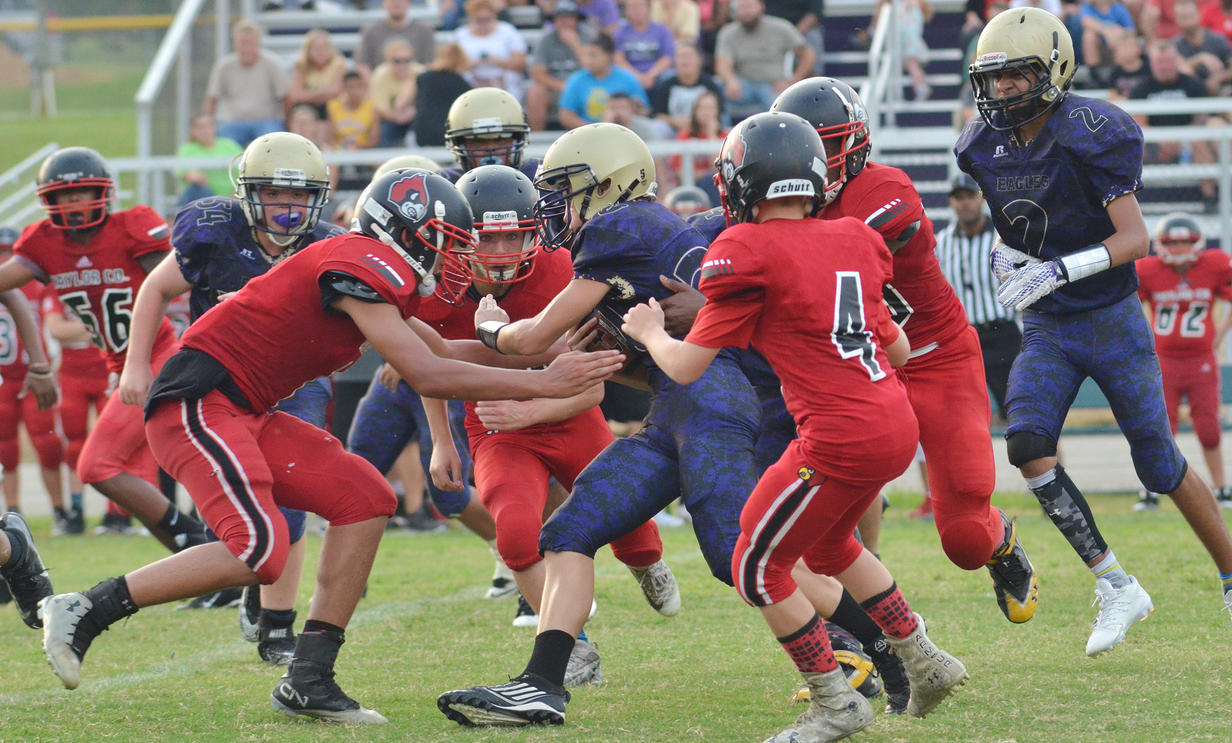 CMS seventh-grader Damon Johnson runs through Taylor County defenders.