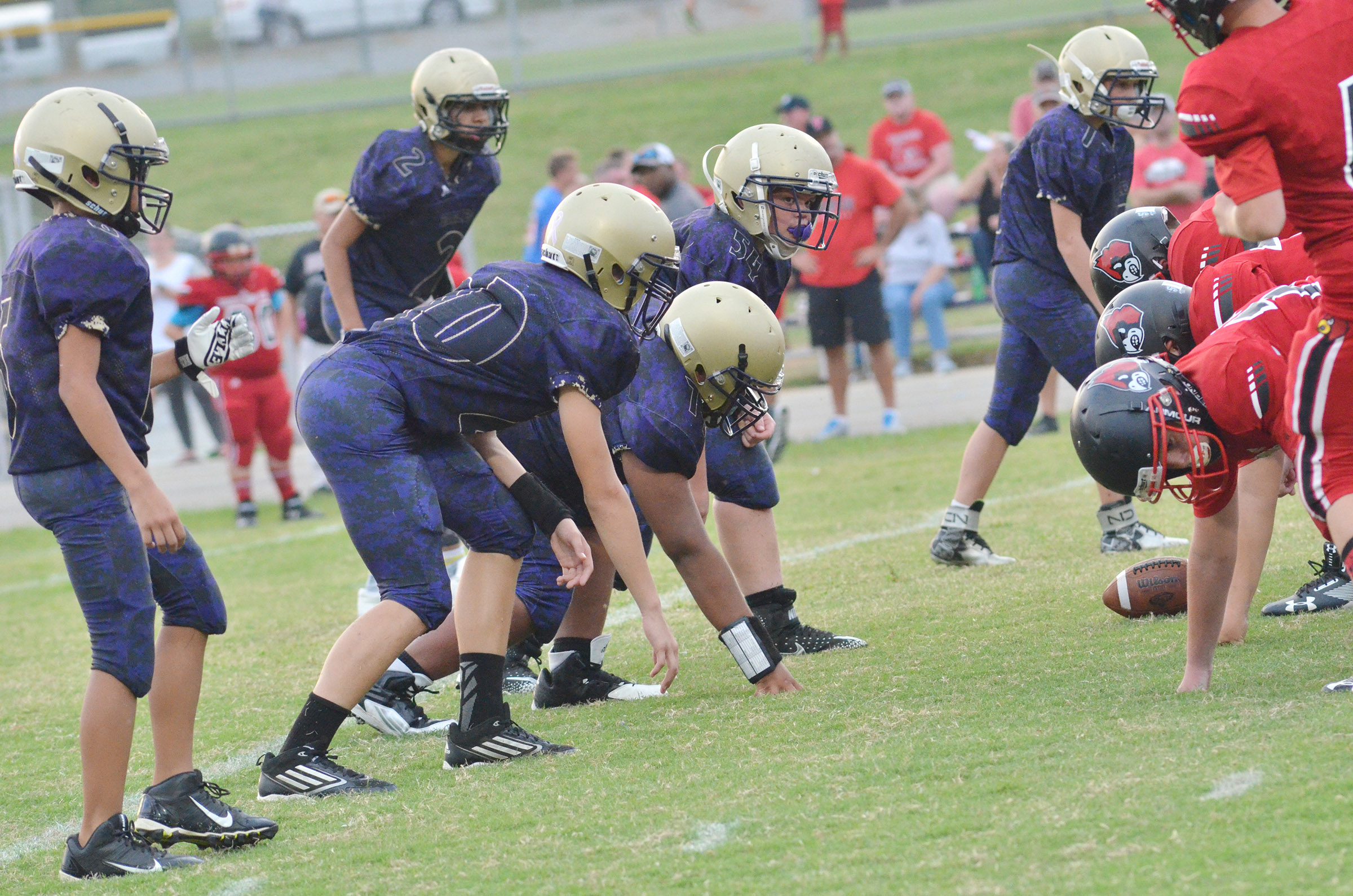 CMS defensive line players get set.