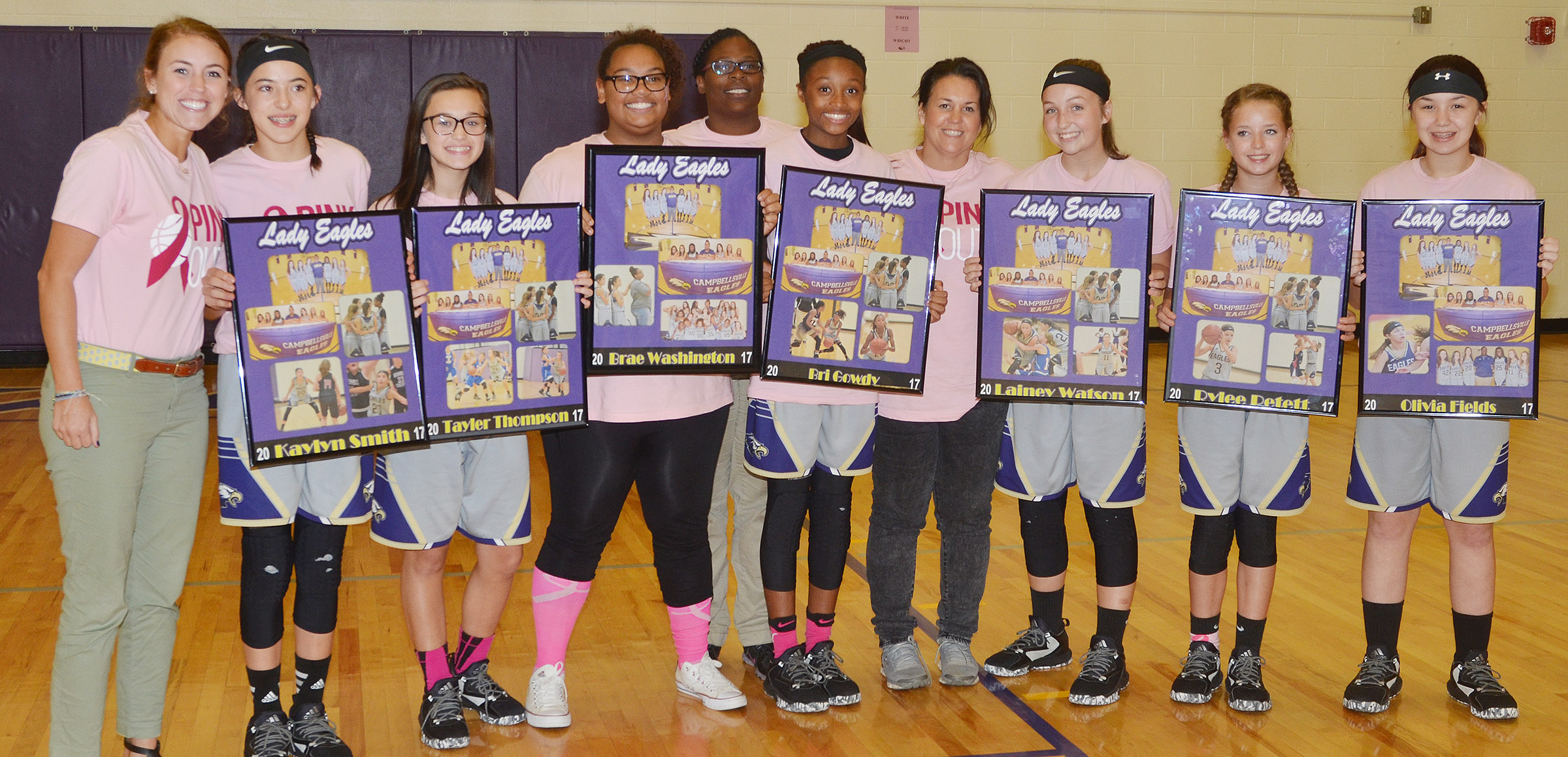 CMS girls' basketball eighth-grade players are honored. From left are assistant coach LeeAnn Grider, Kaylyn Smith, Tayler Thompson, Brae Washington, head coach Tiarra Cecil, Bri Gowdy, assistant coach Kathy England, Lainey Watson, Rylee Petett and Olivia Fields.