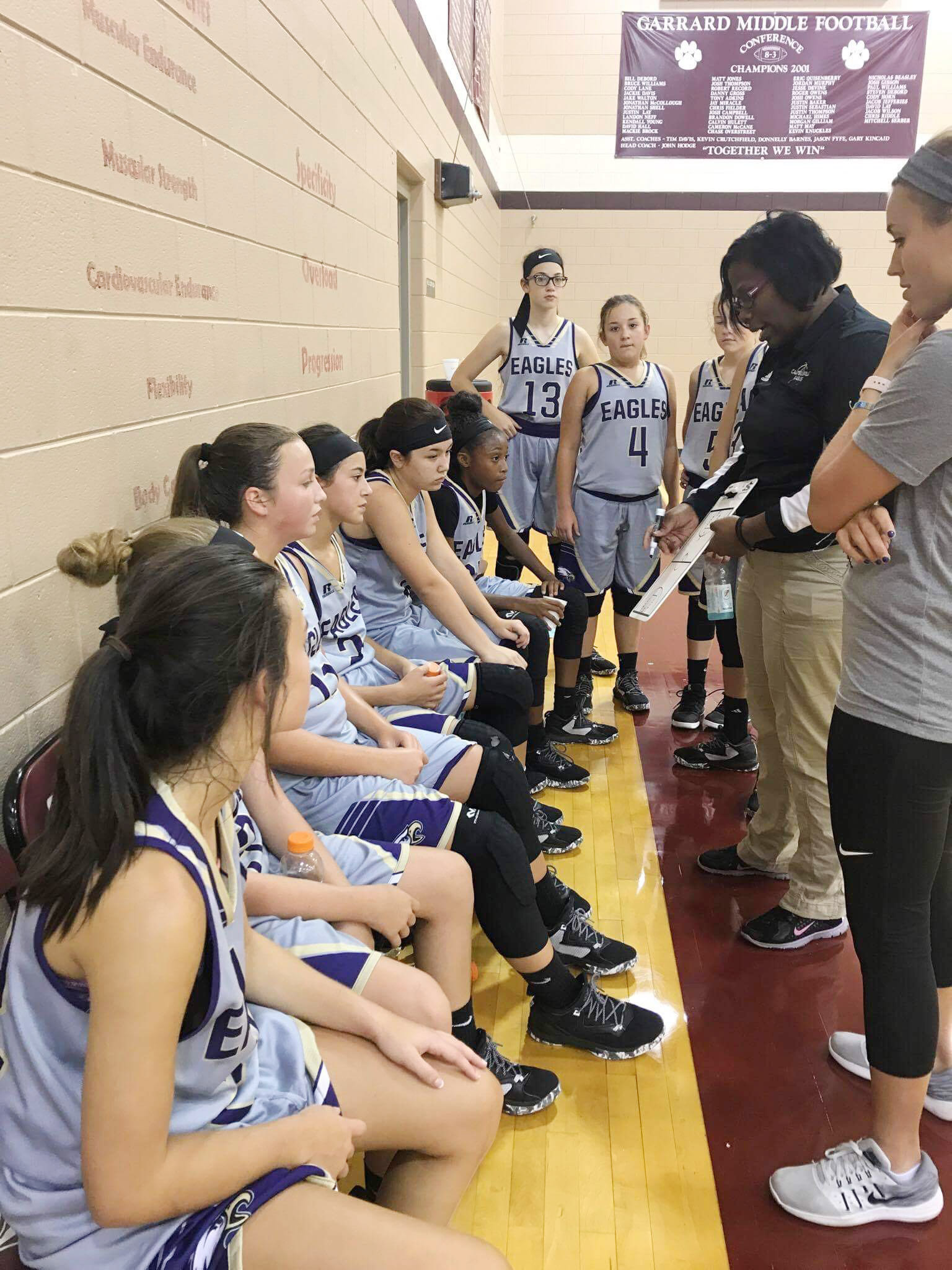 CMS girls' basketball head coach Tiarra Cecil talks to her players during a game.