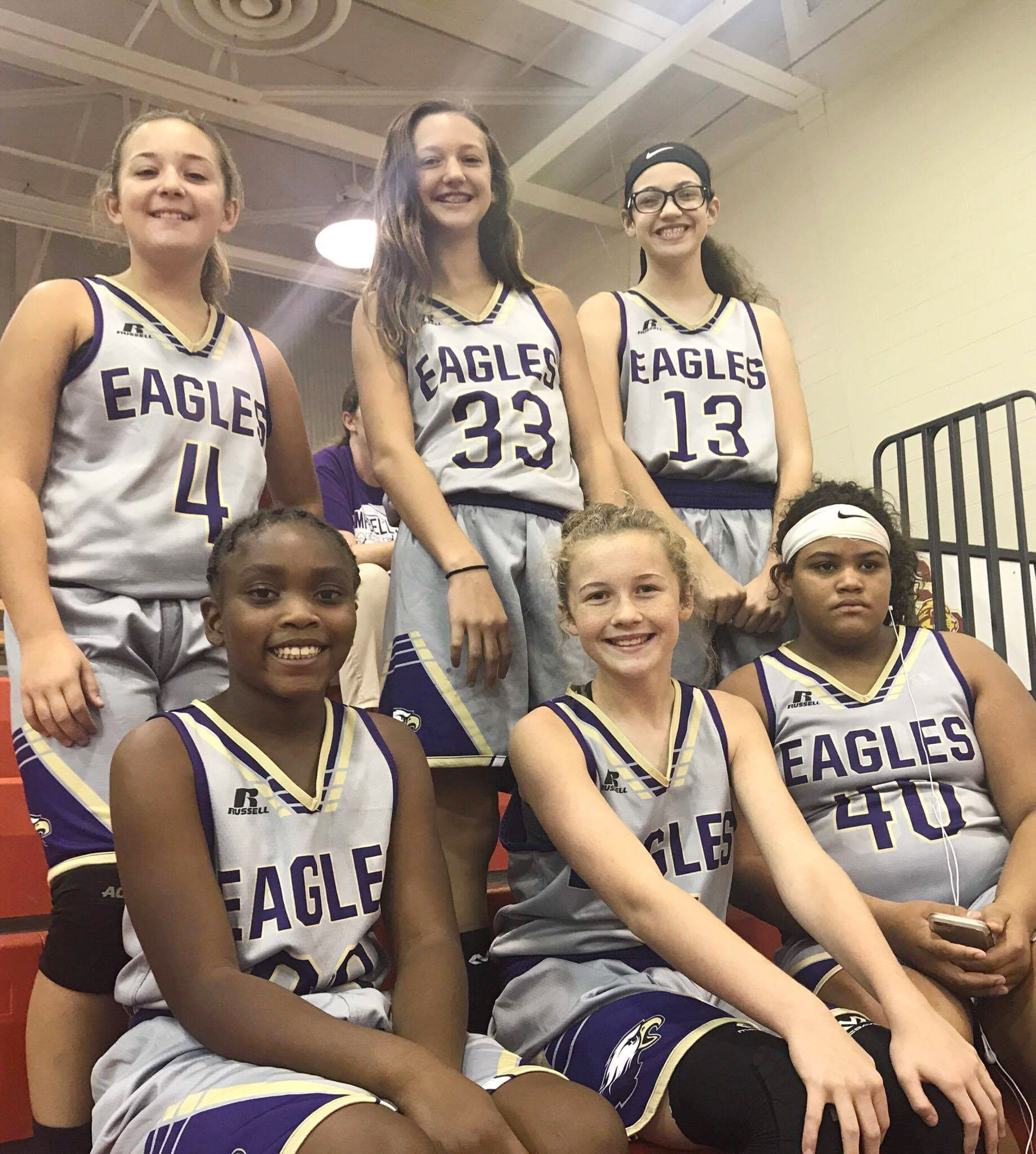 Some of the CMS girls' basketball players pose for a photo before their game. From left, front, are Campbellsville Elementary School fifth-grader Ta'Zaria Owens and seventh-graders Dakota Slone and Asia Barbour. Back, seventh-graders Briana Davis, Bri Hayes and Mary Russell.