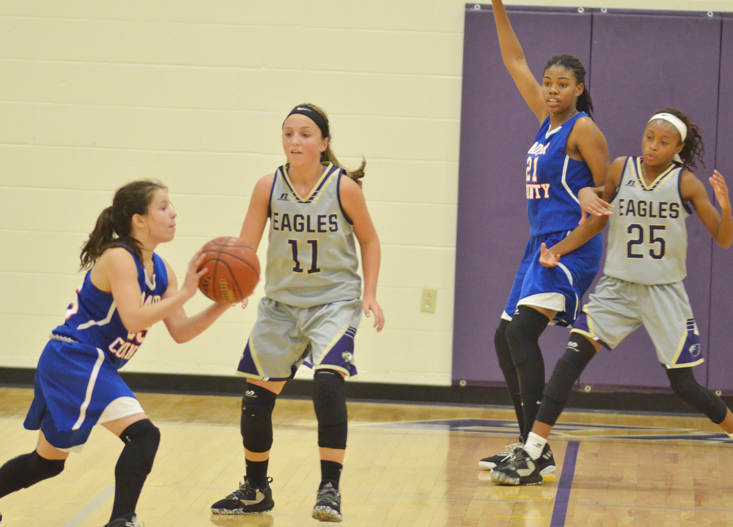 CMS eighth-graders Lainey Watson, at left, and Bri Gowdy play defense.