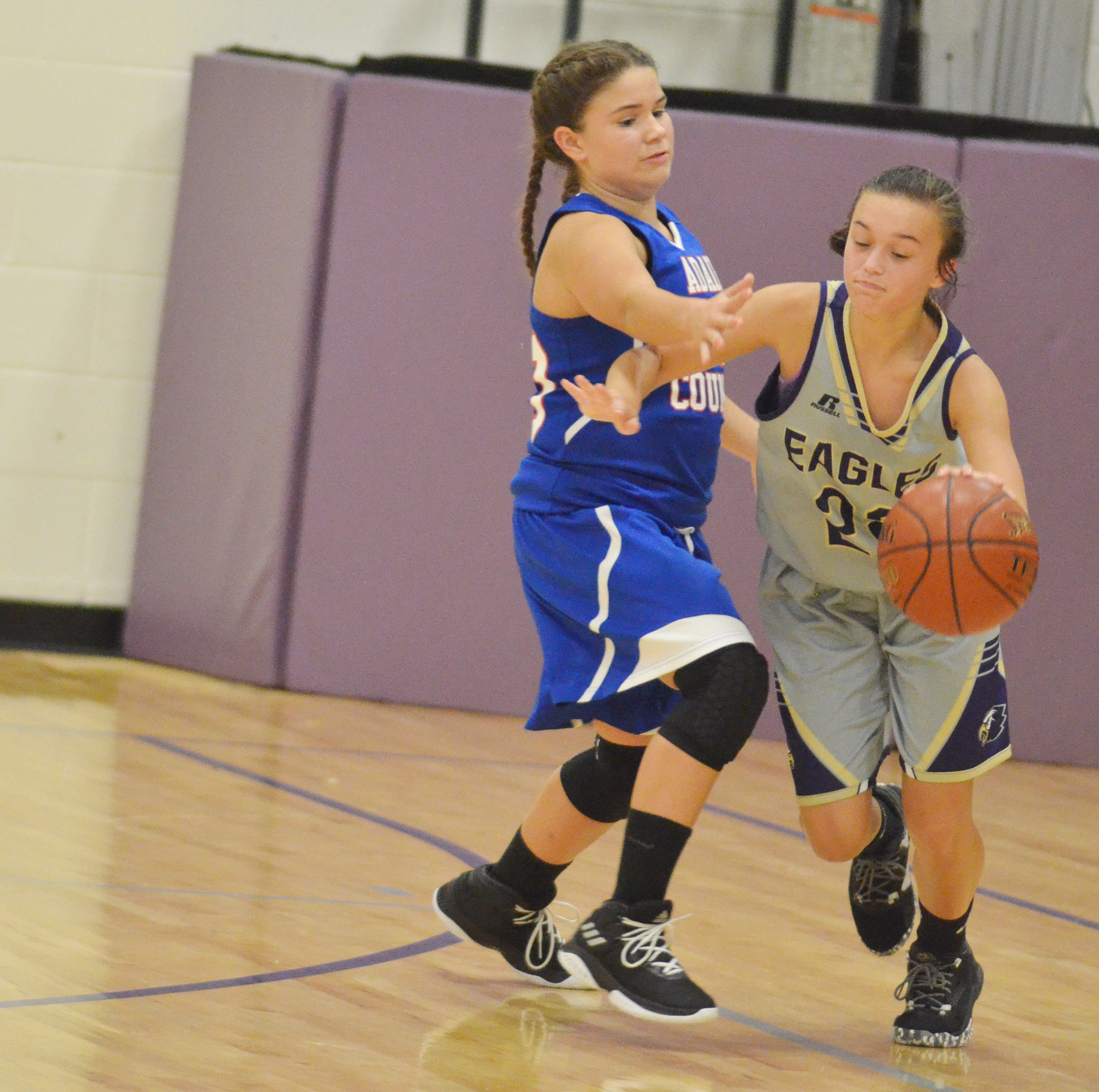 CMS eighth-grader Tayler Thompson dribbles.