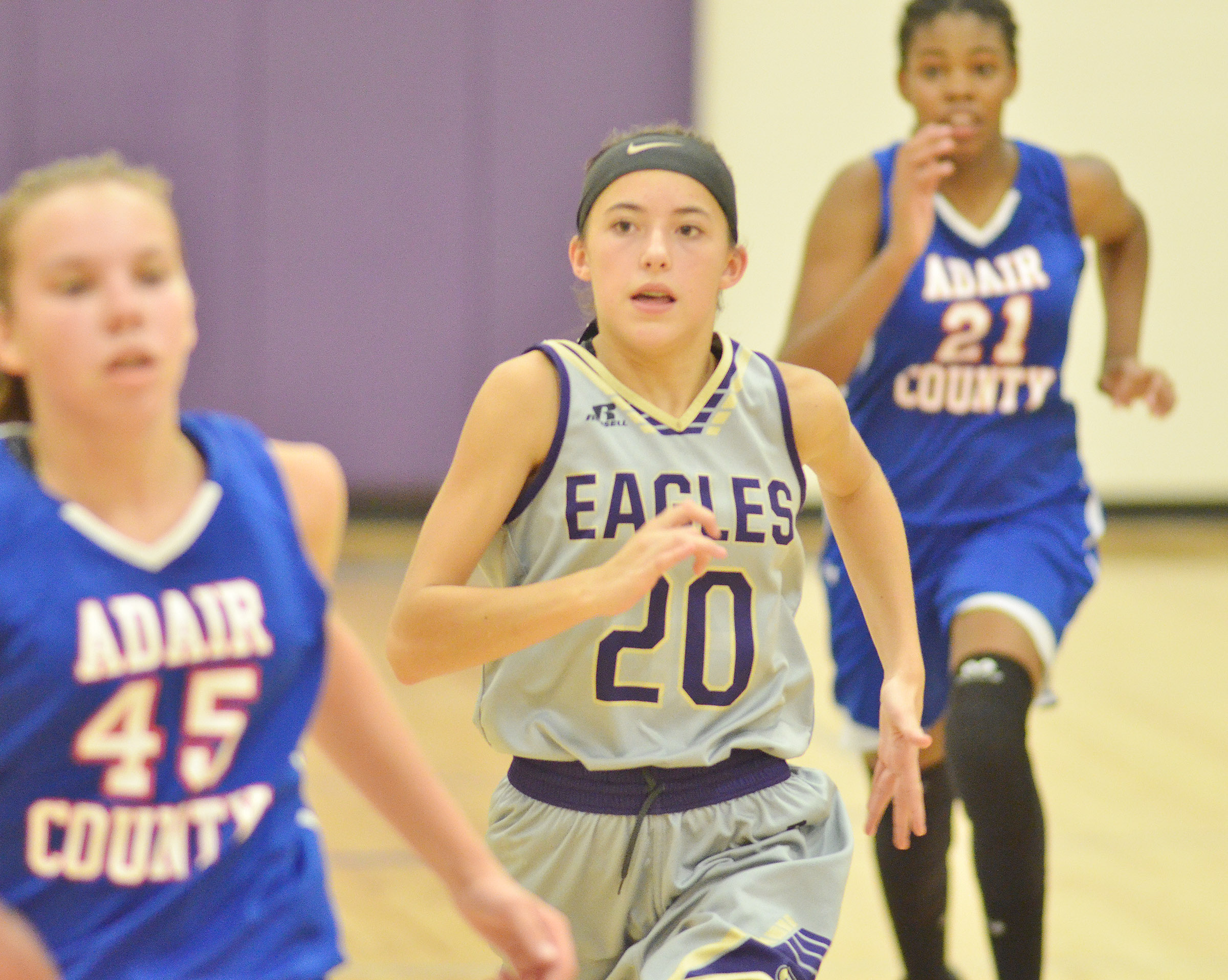 CMS eighth-grader Kaylyn Smith runs to the basket.
