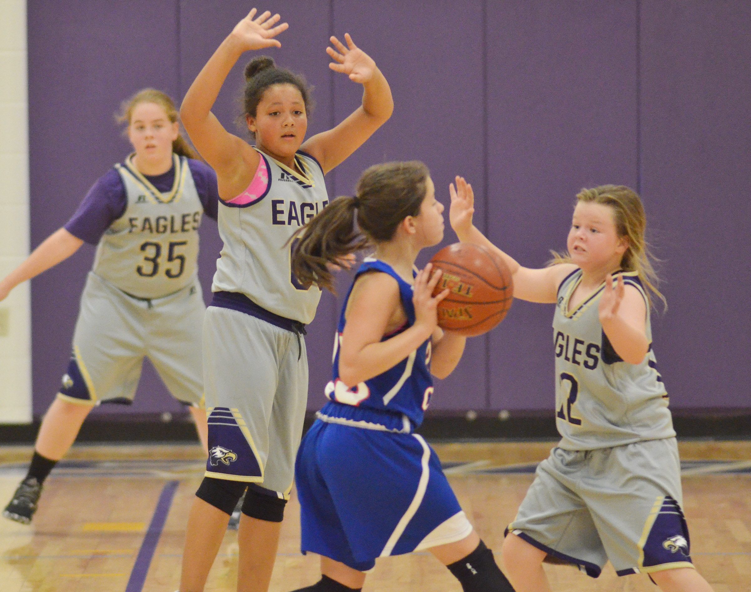 CMS sixth-grader Layla Steen, at left, and Campbellsville Elementary School fifth-graders Kenya Bridgewater and Miley Hash play defense.