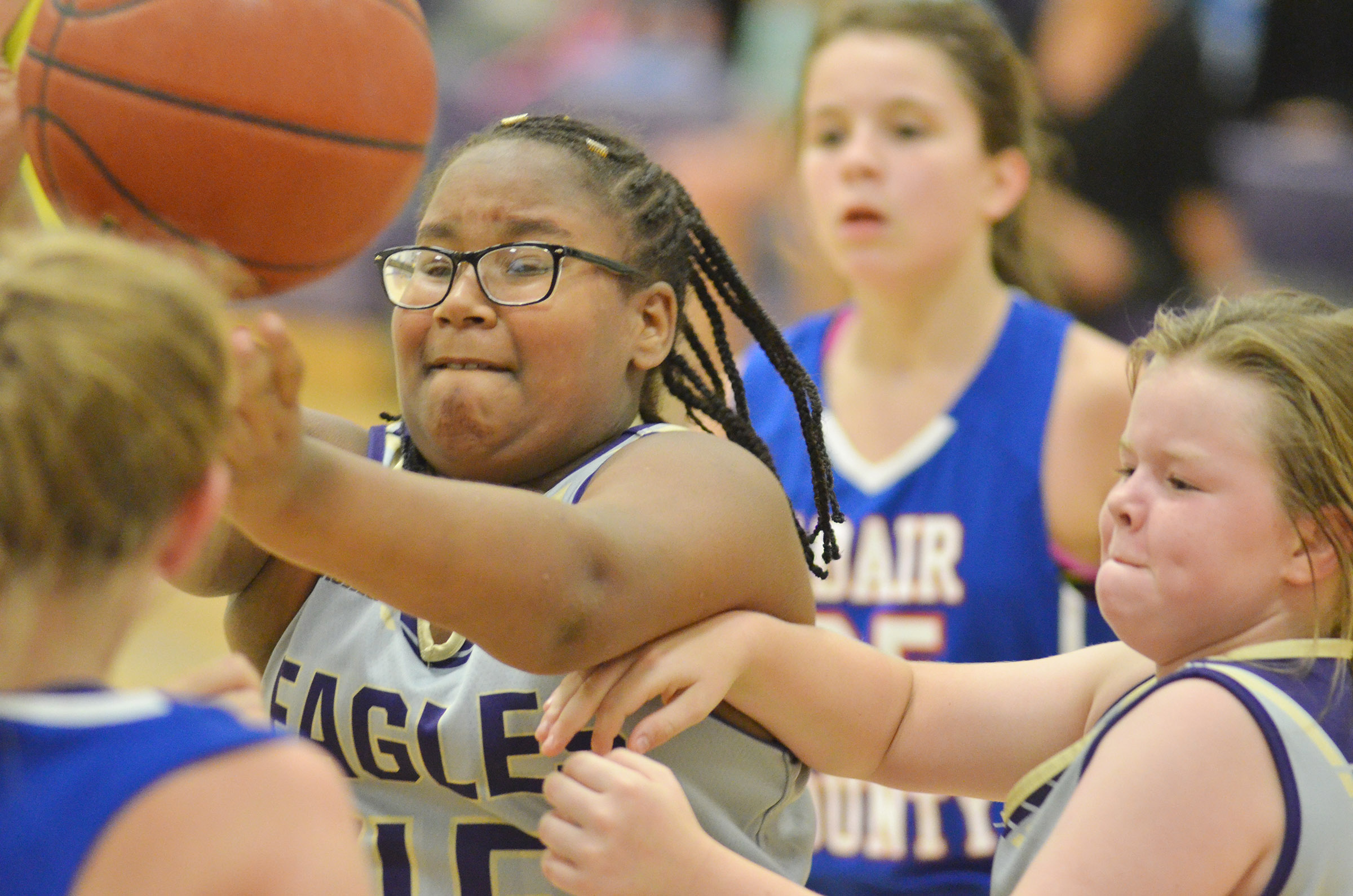 CMS sixth-grader KyAshia Mitchell, at left, and Campbellsville Elementary School fifth-grader Miley Hash battle for the ball.