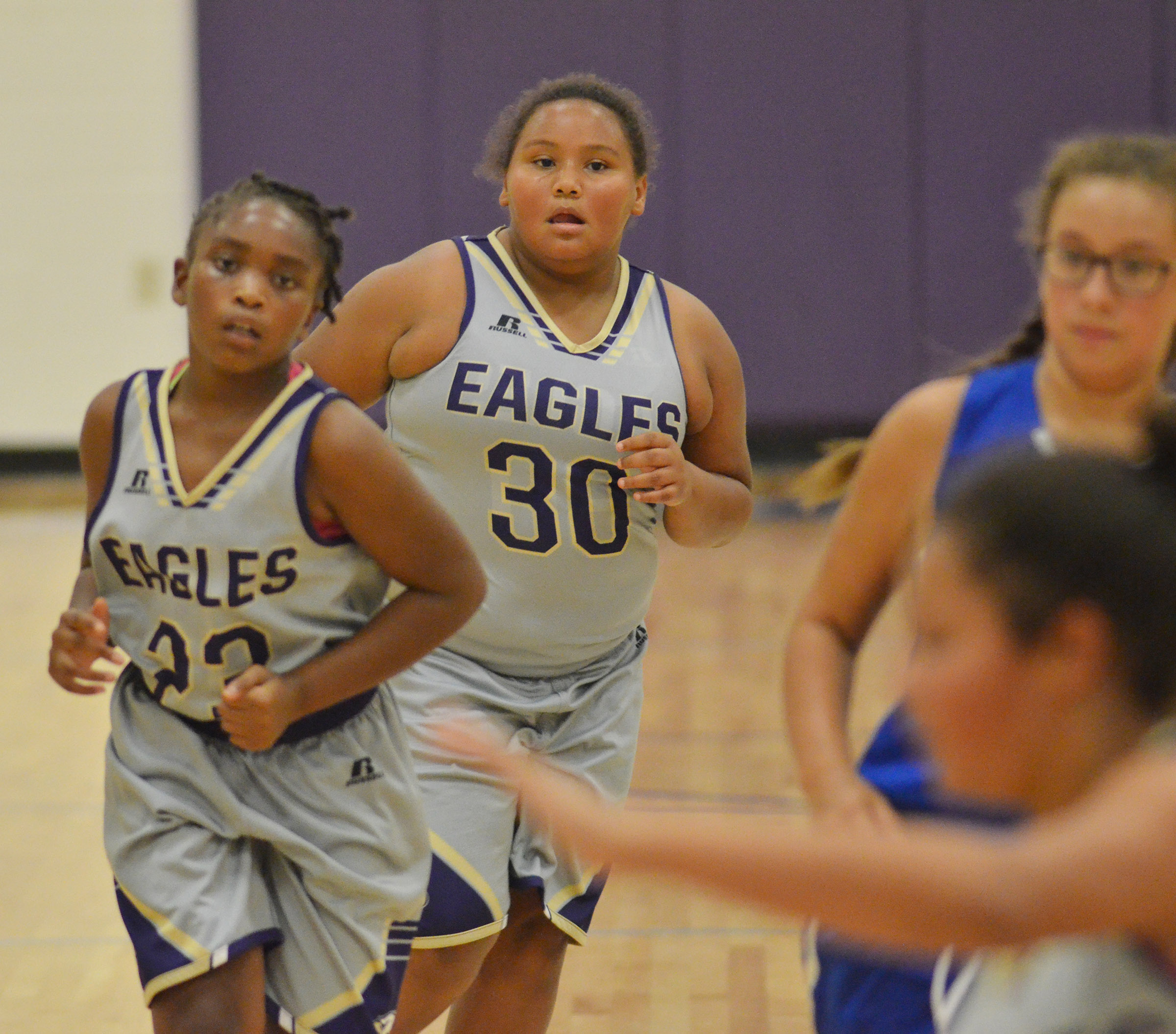Campbellsville Elementary School fifth-grader Dezarae Washington runs down the court.