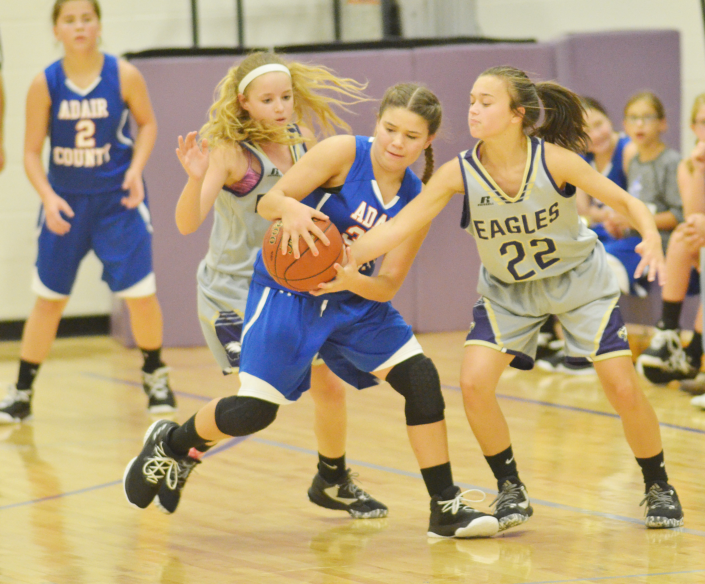CMS eighth-graders Rylee Petett, at left, and Tayler Thompson play defense.