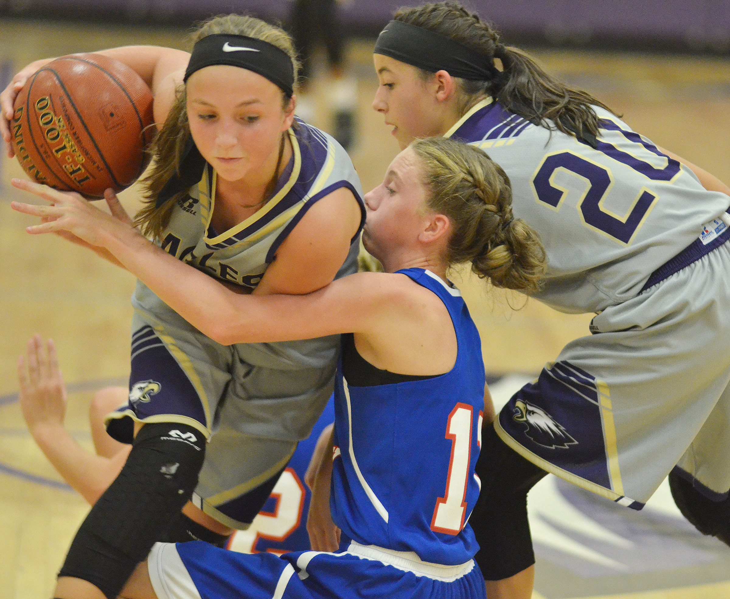 CMS eighth-graders Lainey Watson, at left, and Kaylyn Smith battle for the ball.