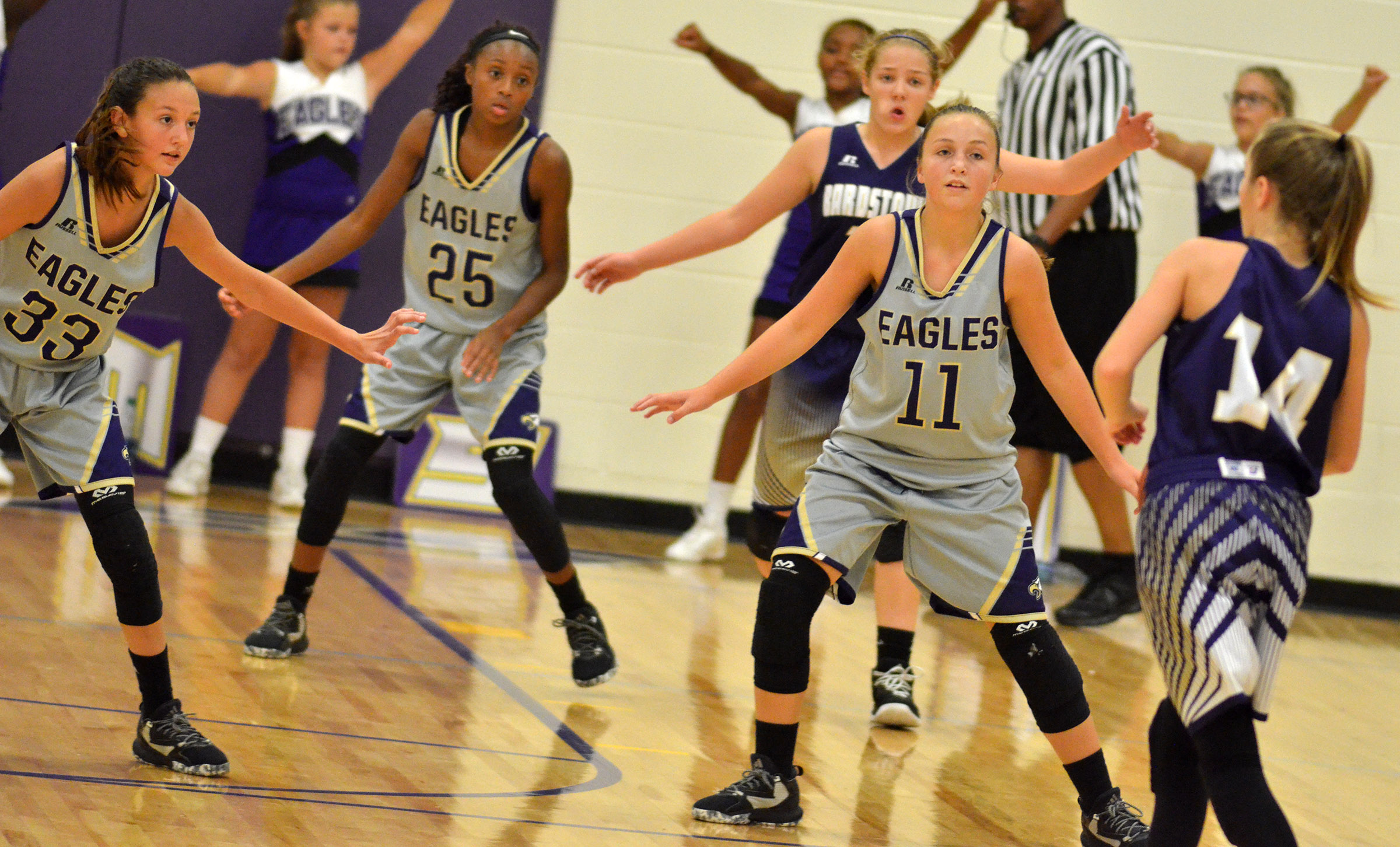 From left, CMS seventh-grader Bri Hayes and eighth-graders Bri Gowdy and Lainey Watson play defense.