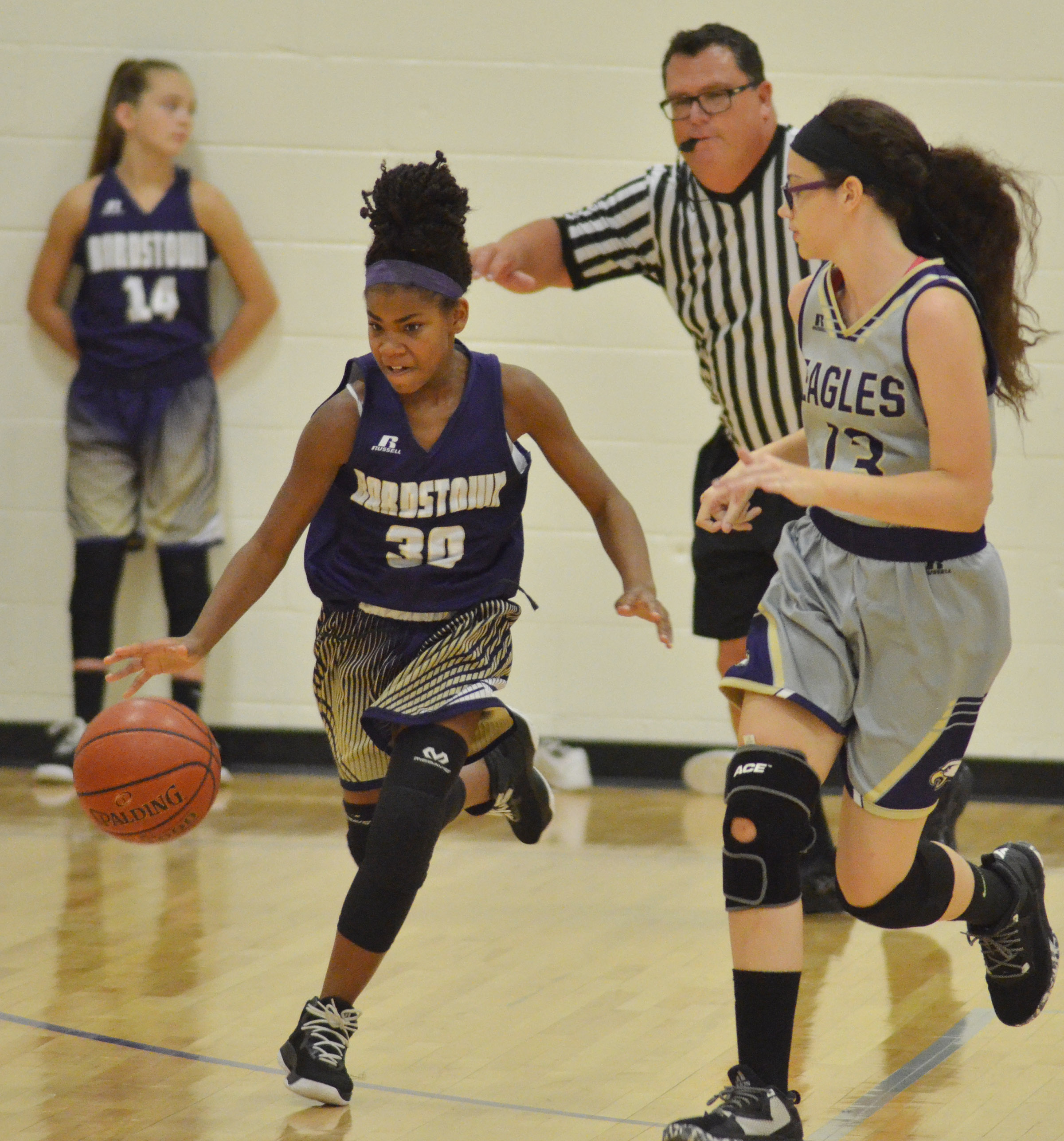 CMS seventh-grader Mary Russell plays defense.