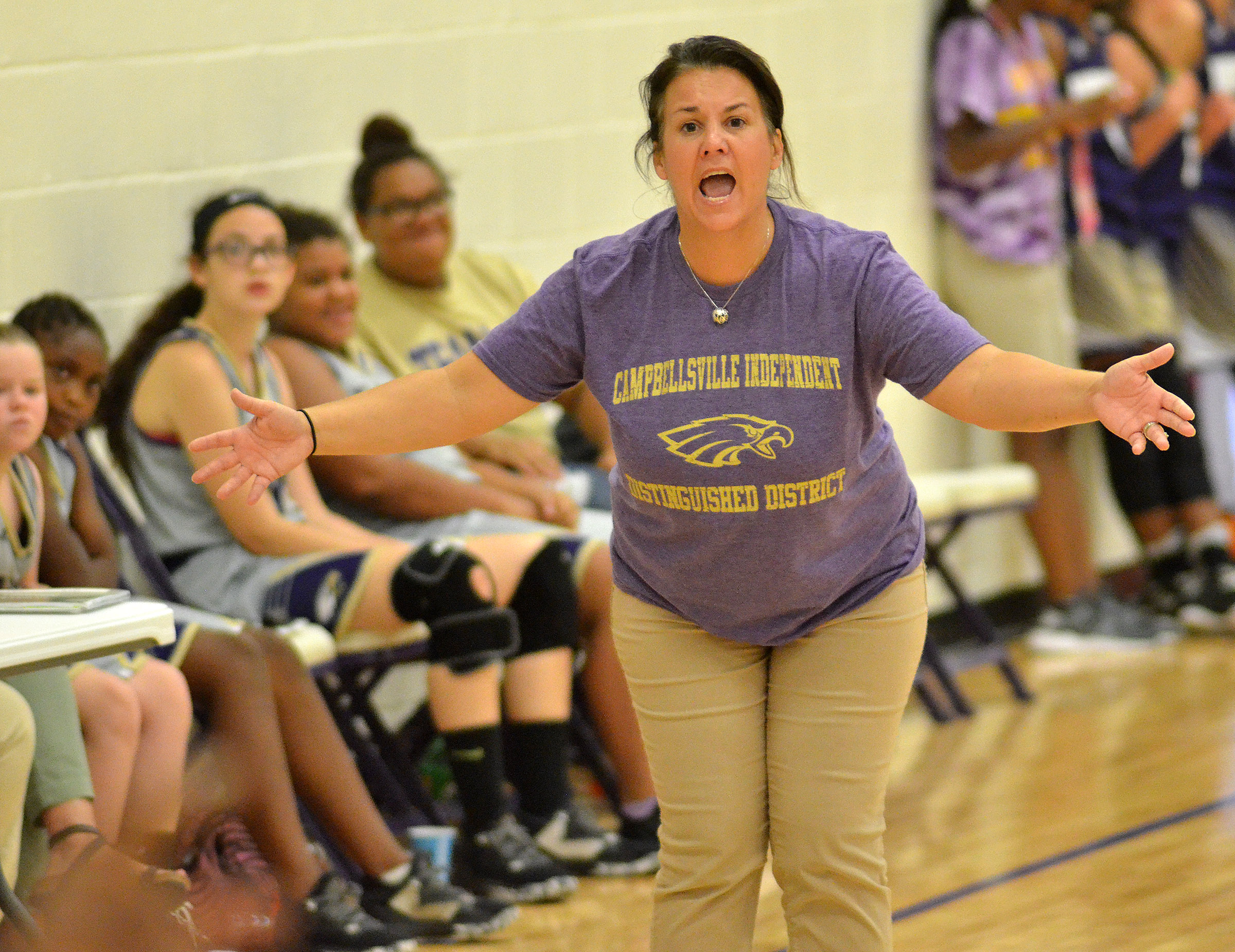 CMS assistant girls' basketball coach Kathy England yells to her players.