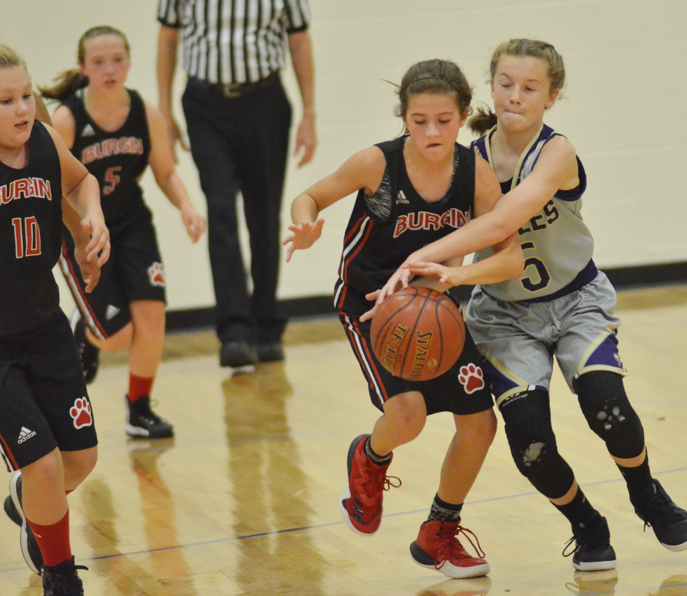 CMS seventh-grader Dakota Slone tries to steal the ball.