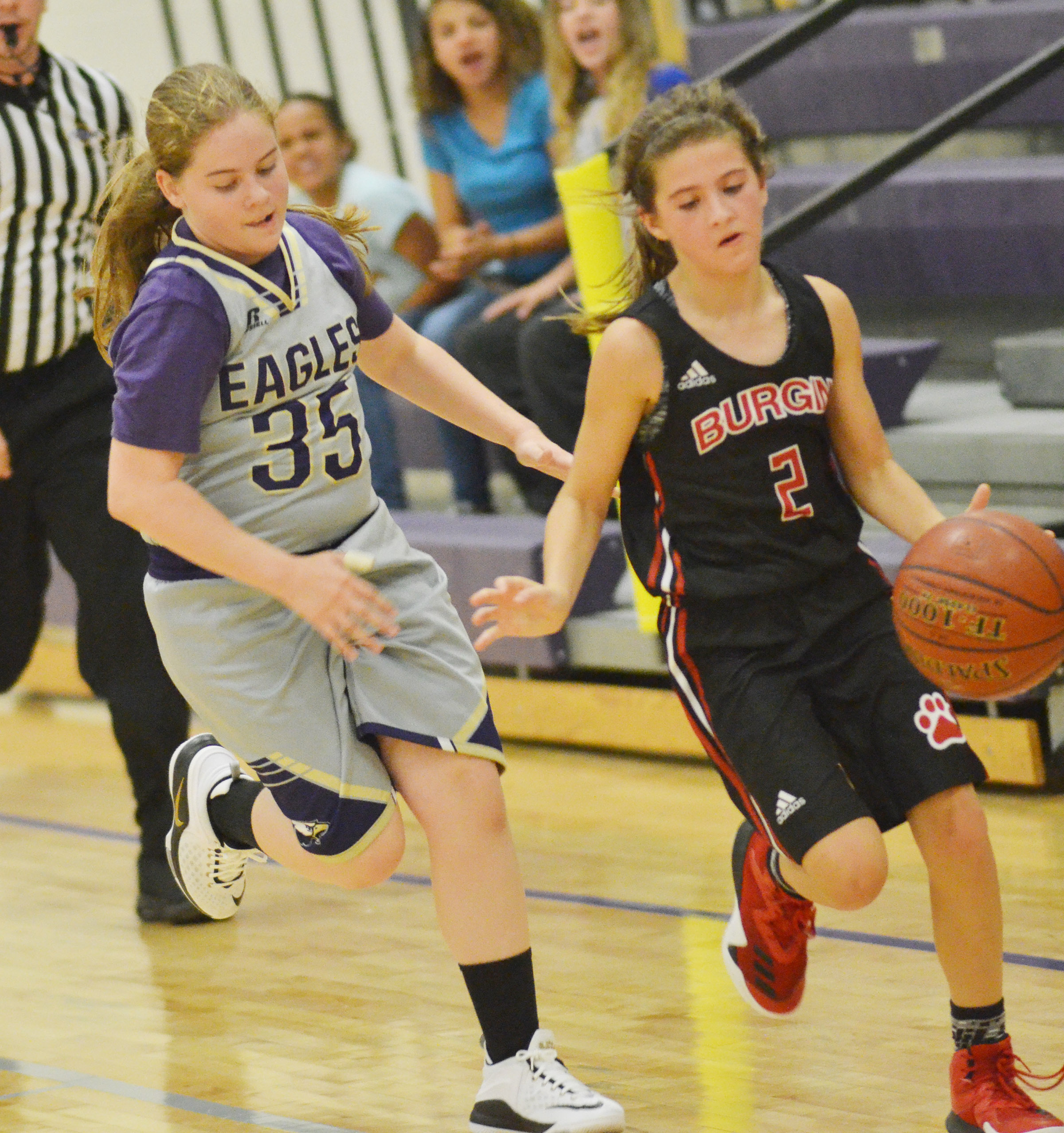 CMS sixth-grader Layla Steen runs after a Burgin player.