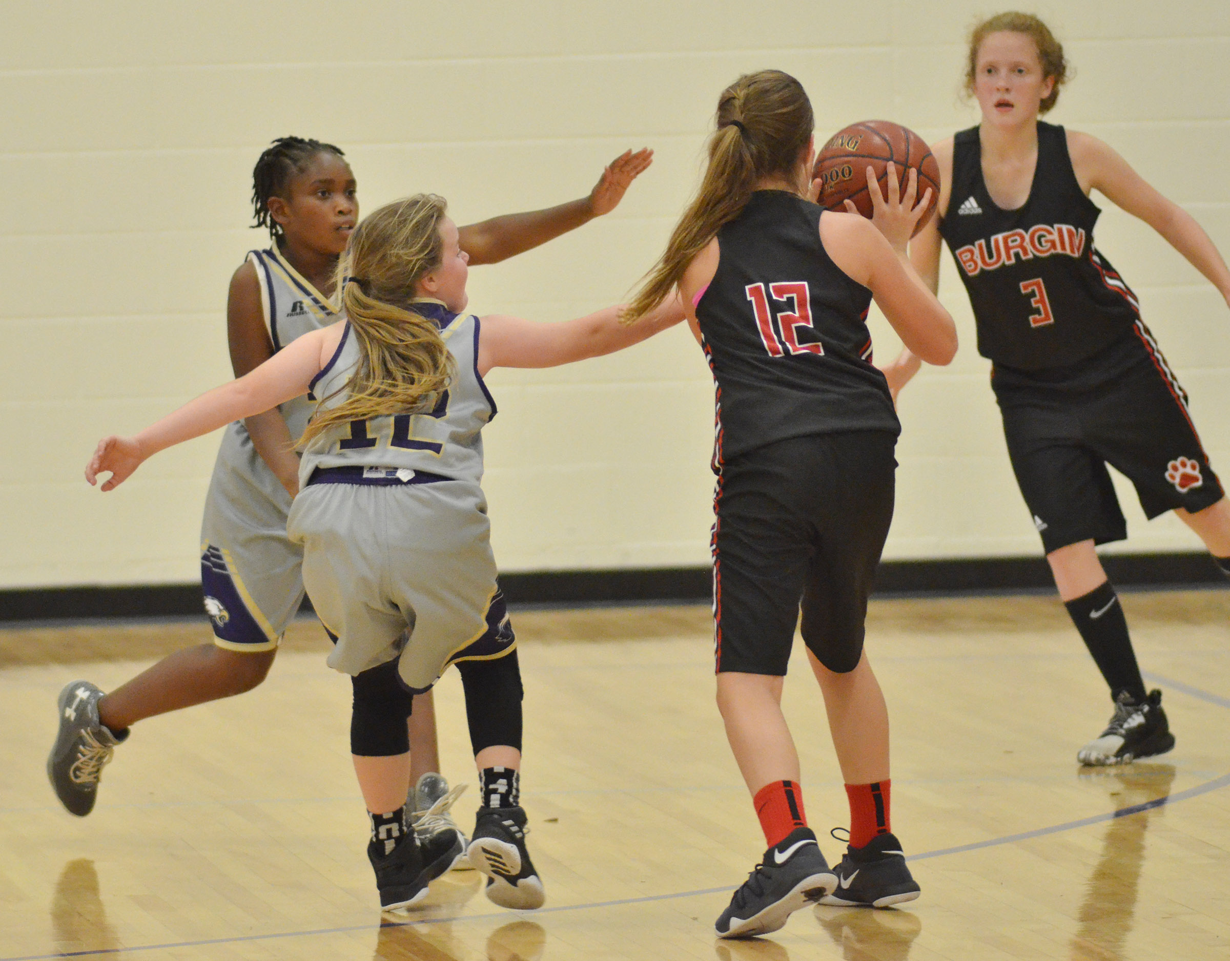Campbellsville Elementary School fifth-graders Ta'Zaria Owens, at left, and Miley Hash play defense.