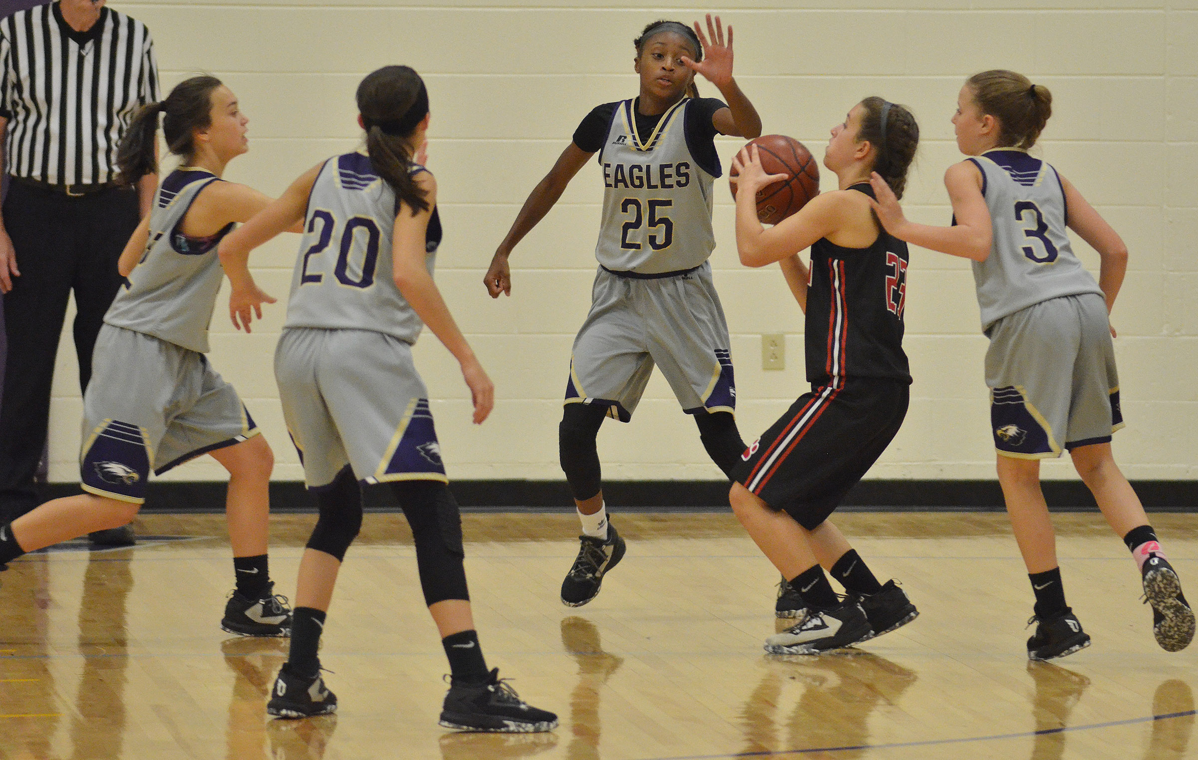 From left, CMS eighth-graders Tayler Thompson, Kaylyn Smith, Bri Gowdy and Rylee Petett play defense.