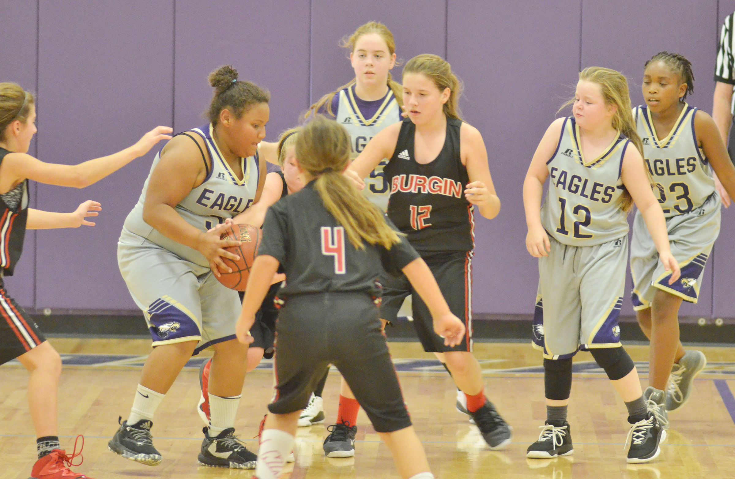 From left, Campbellsville Elementary School fifth-grader Dezarae Washington, CMS sixth-grader Layla Steen and fifth-graders Miley Hash and Ta'Zaria Owens play defense.
