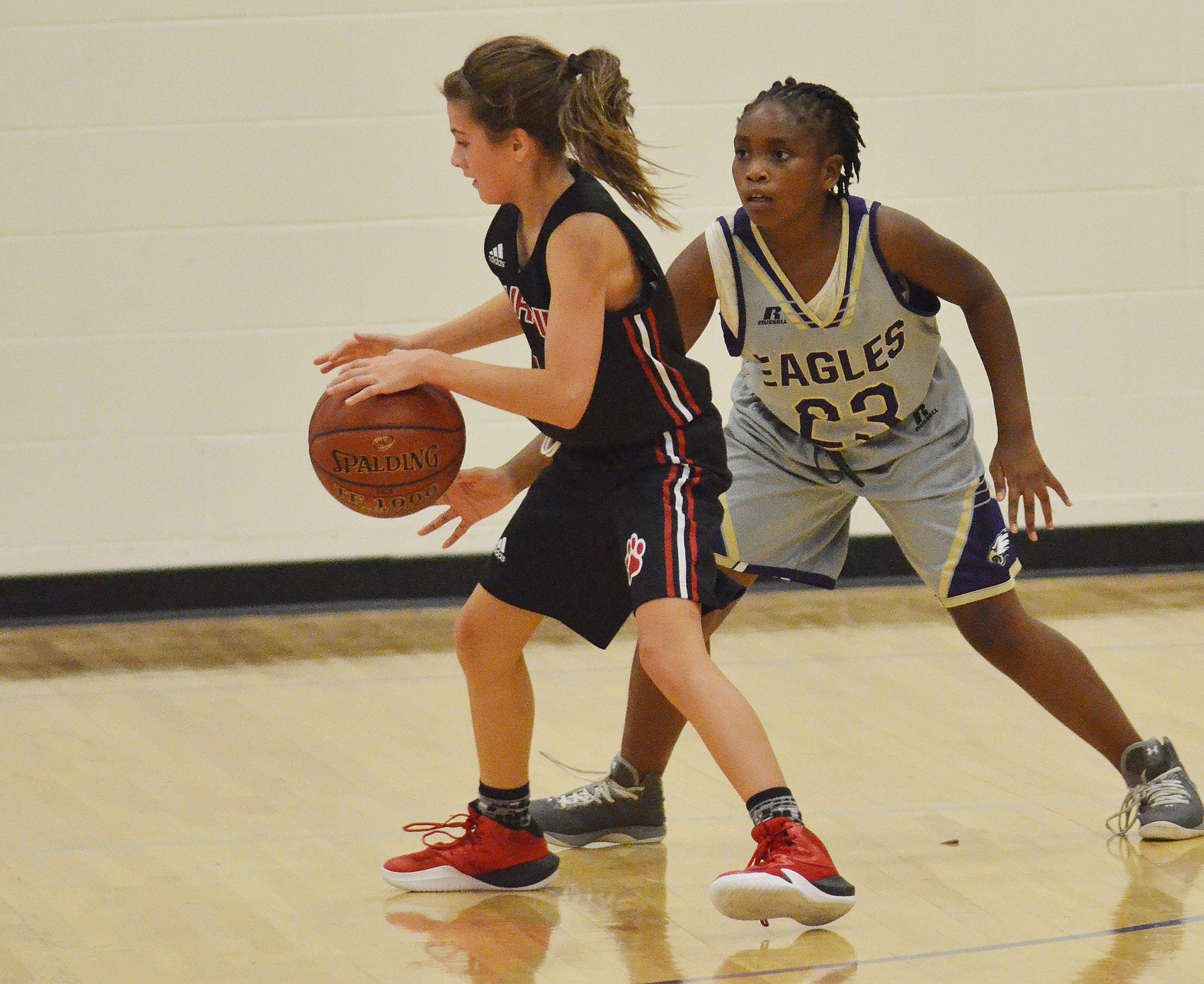 Campbellsville Elementary School fifth-grader Ta'Zaria Owens plays defense.