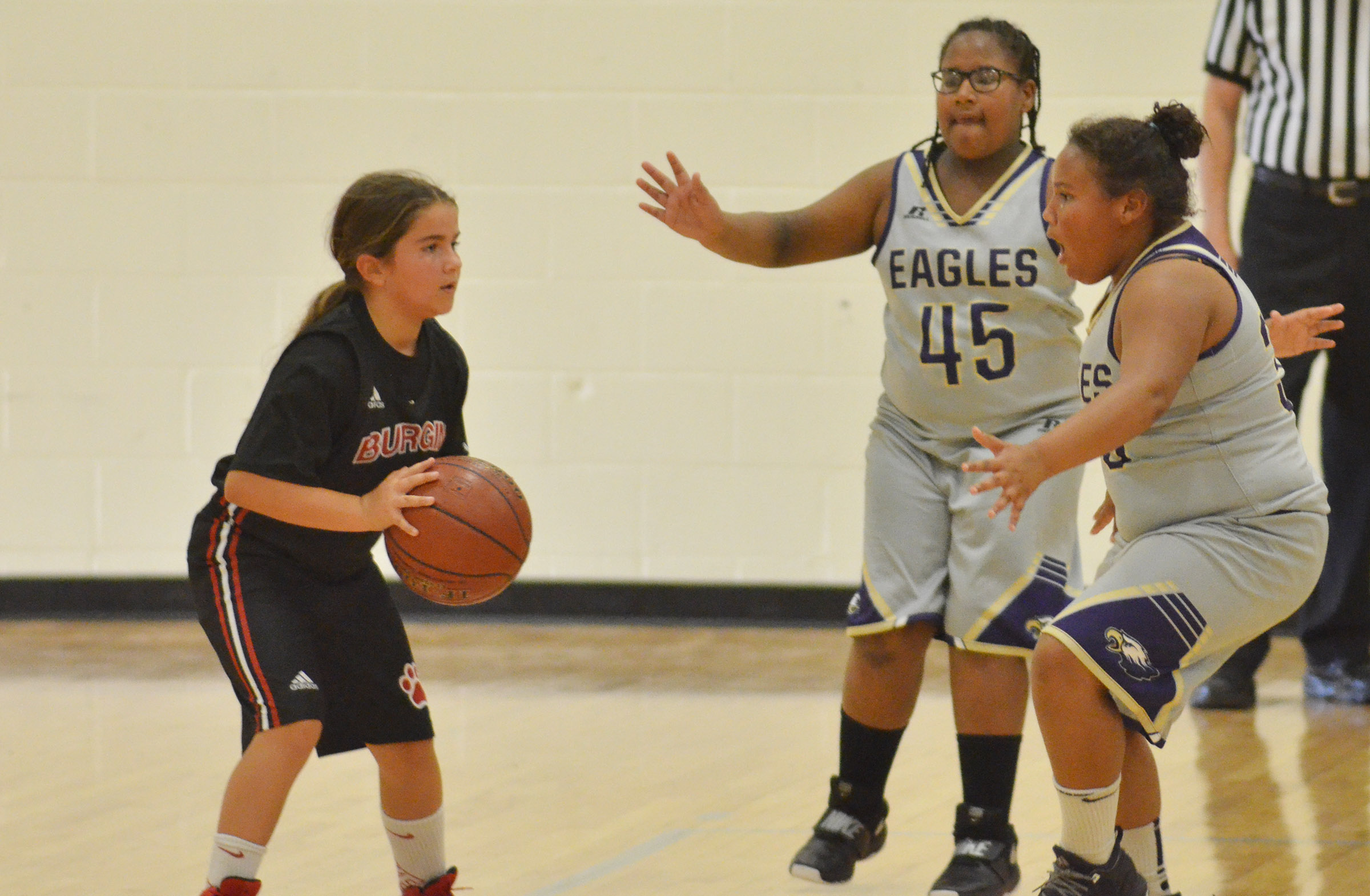 Campbellsville Elementary School fifth-graders KyAshia Mitchell, at left, and Dezarae Washington play defense.