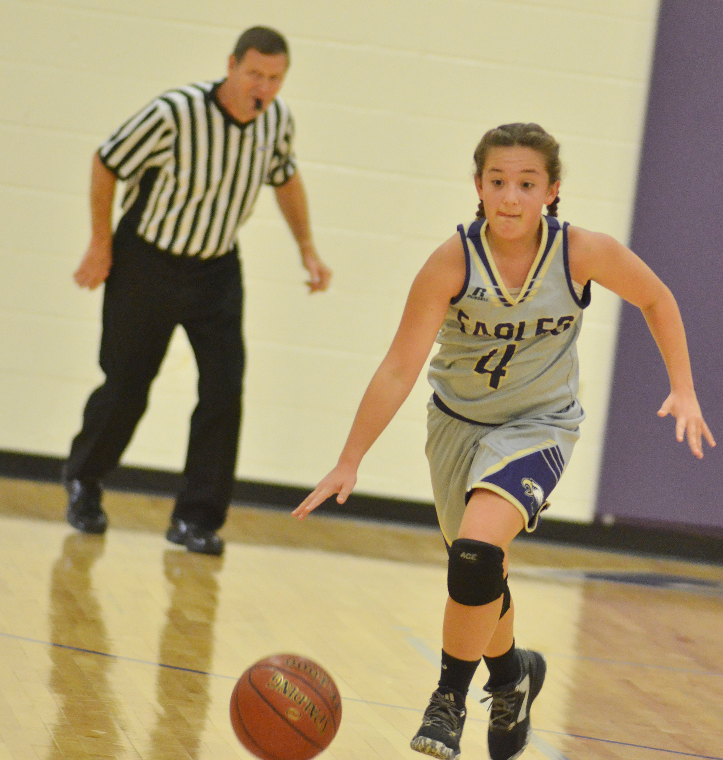 CMS seventh-grader Briana Davis dribbles to the hoop.