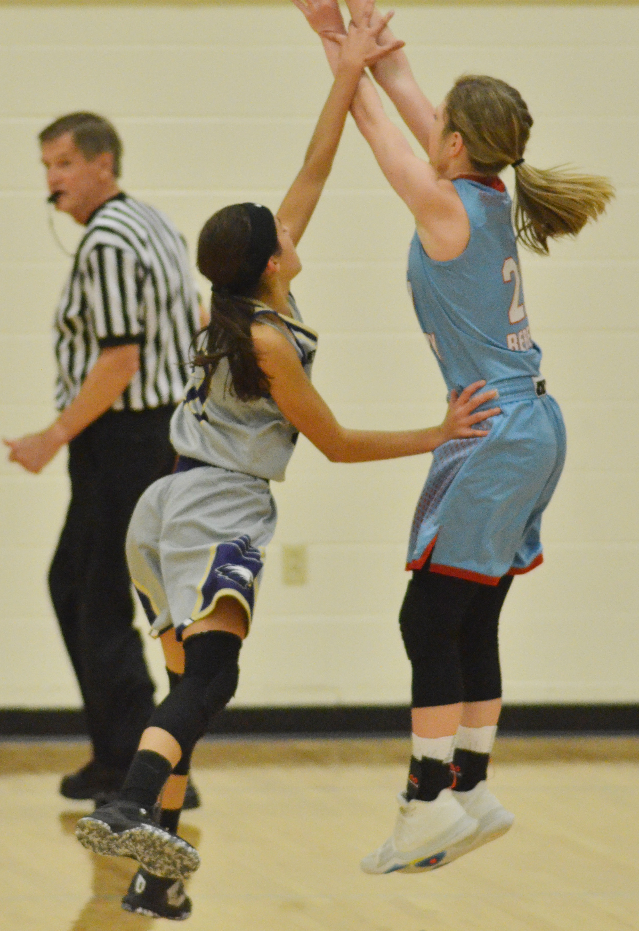 CMS eighth-grader Kaylyn Smith tries to block a shot.