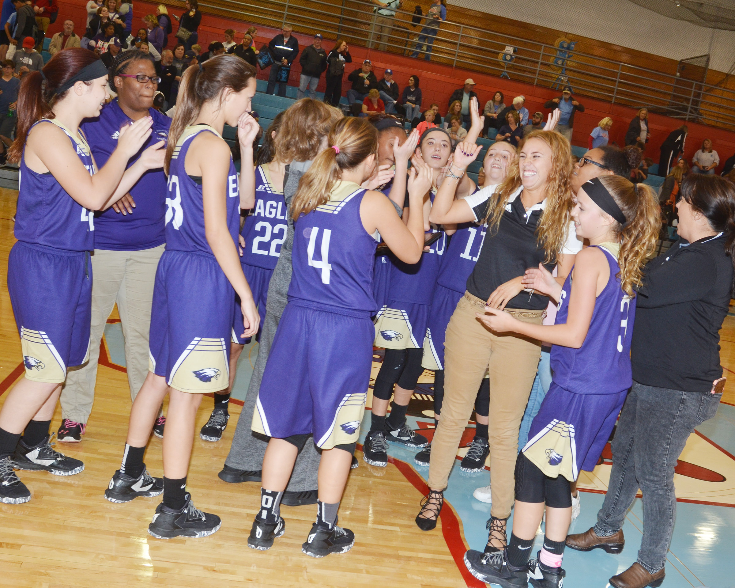 CMS girls' basketball players celebrate their win.