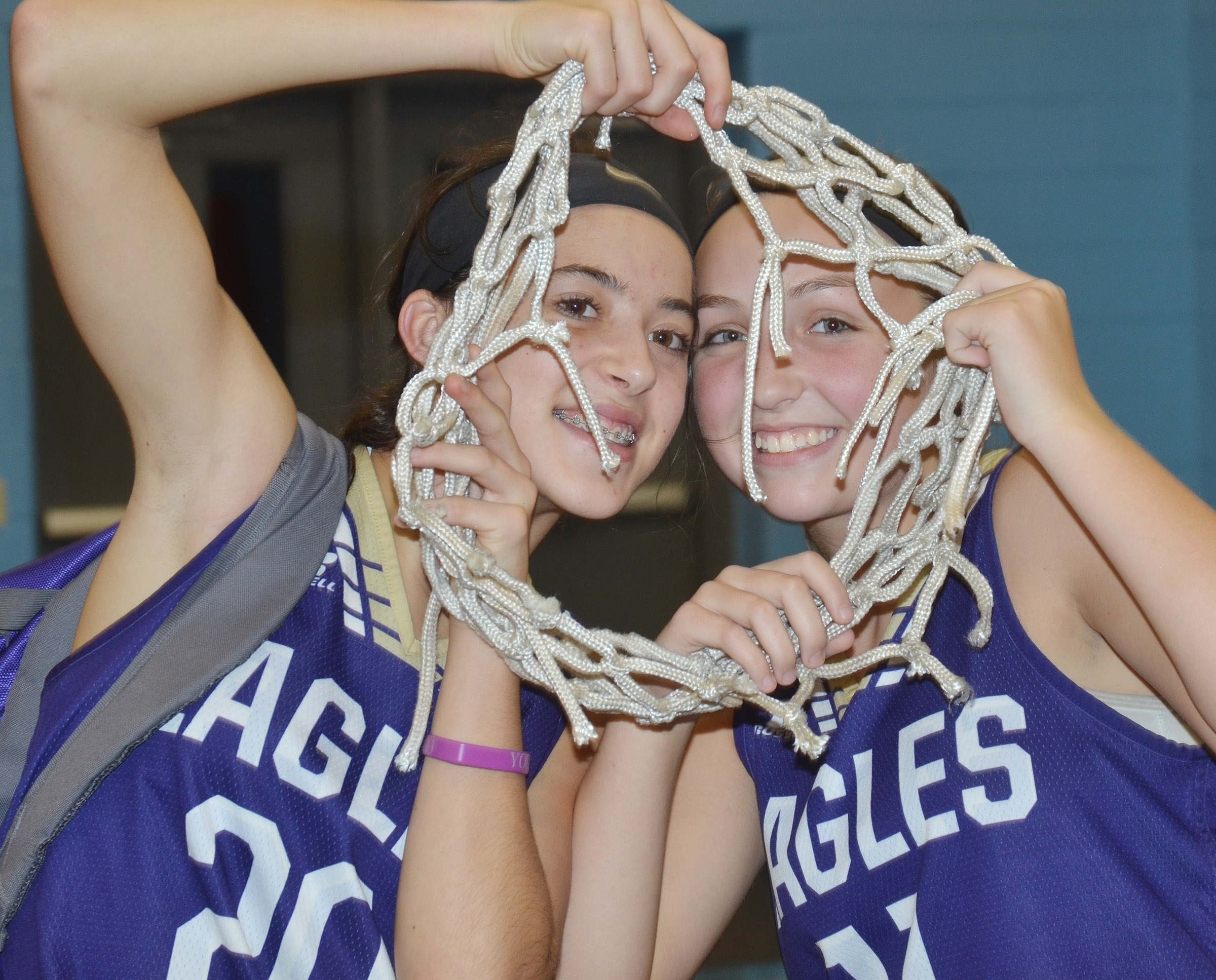 CMS eighth-graders Kaylyn Smith, at left, and Rylee Petett pose for a photo with the championship net.