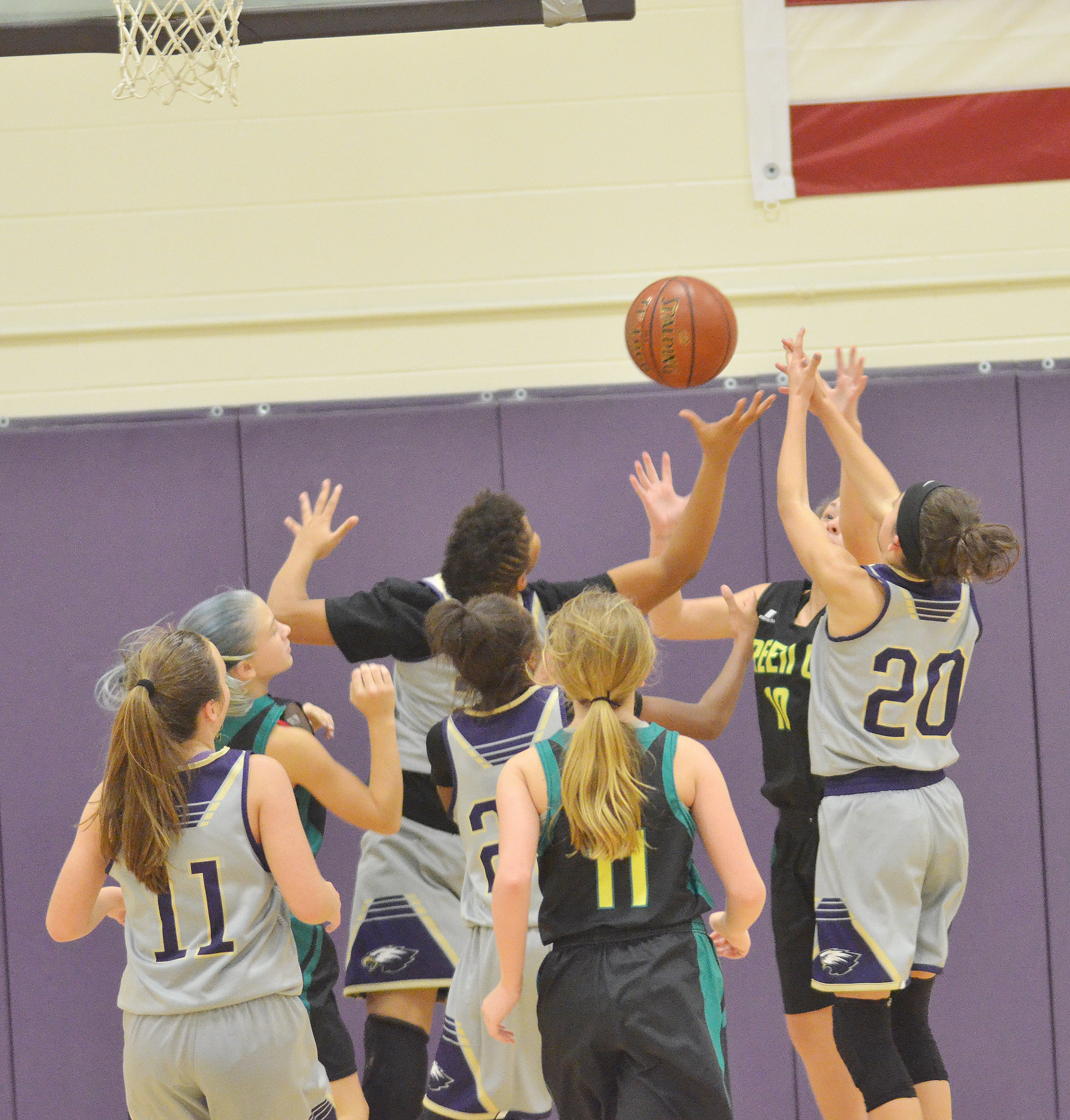 CMS girls' basketball players battle for the rebound.