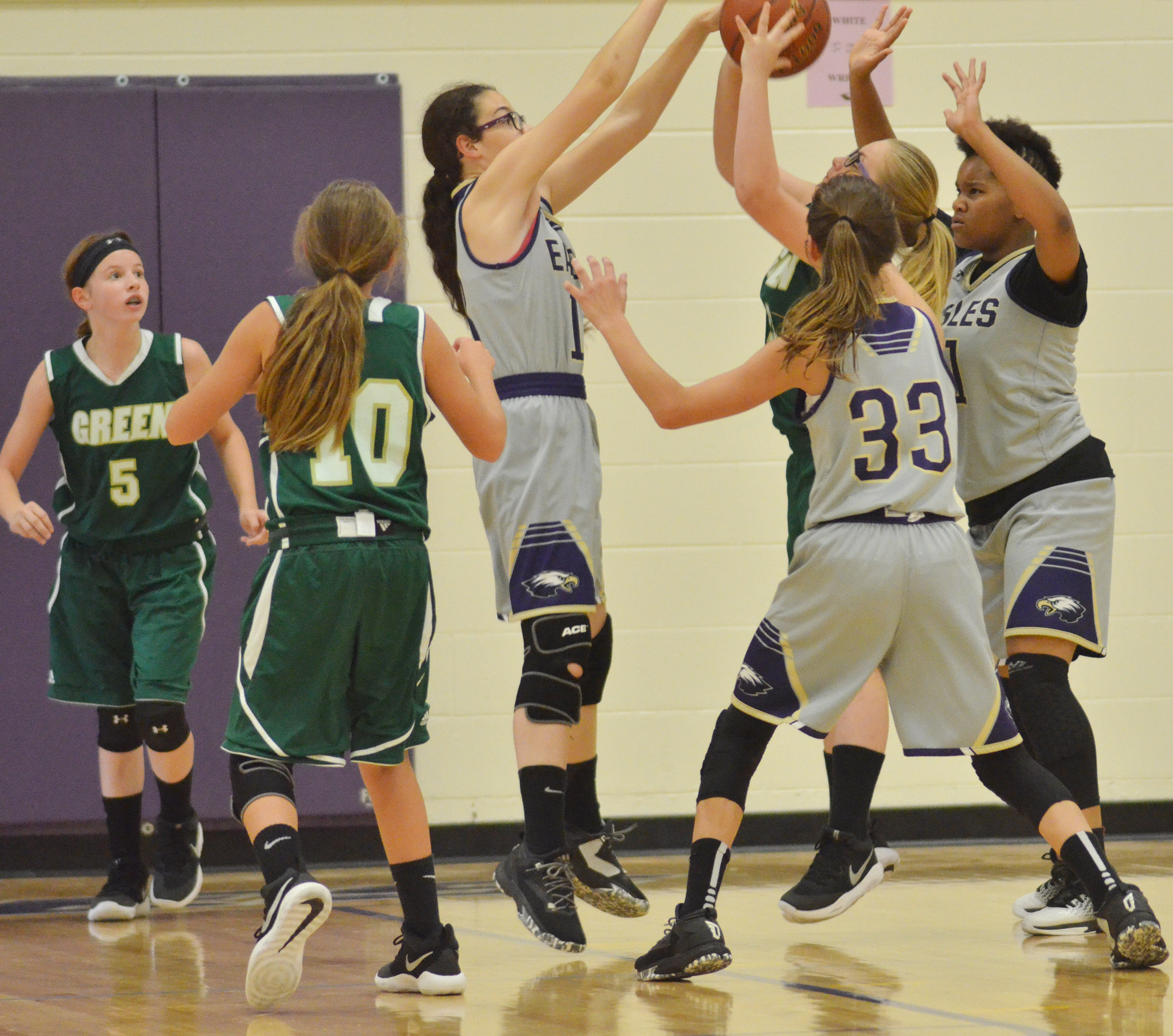 From left, CMS seventh-graders Mary Russell, Bri Hayes and Antaya Epps battle for the ball.