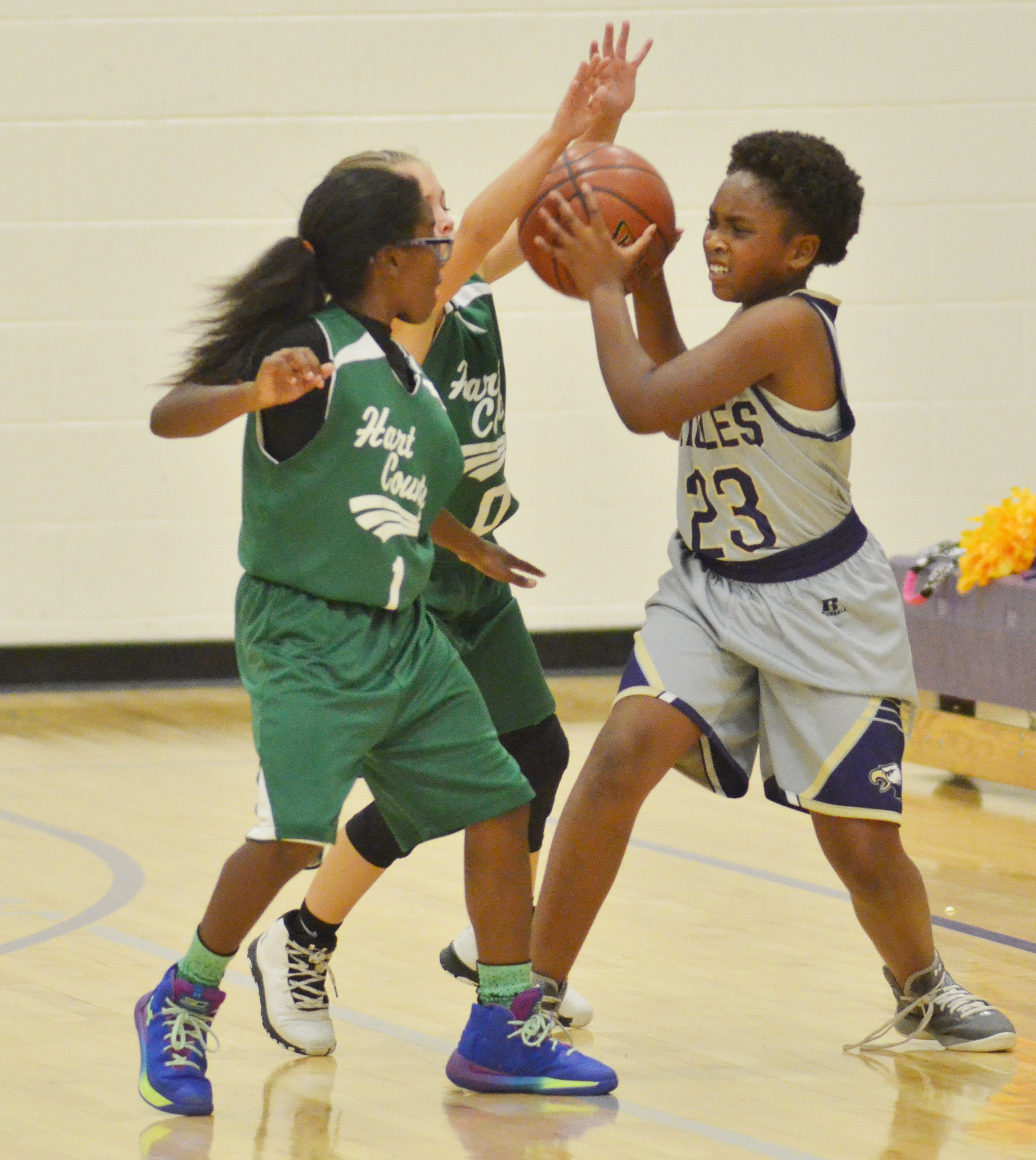 Campbellsville Elementary School fifth-grader Ta'Zaria Owens protects the ball.
