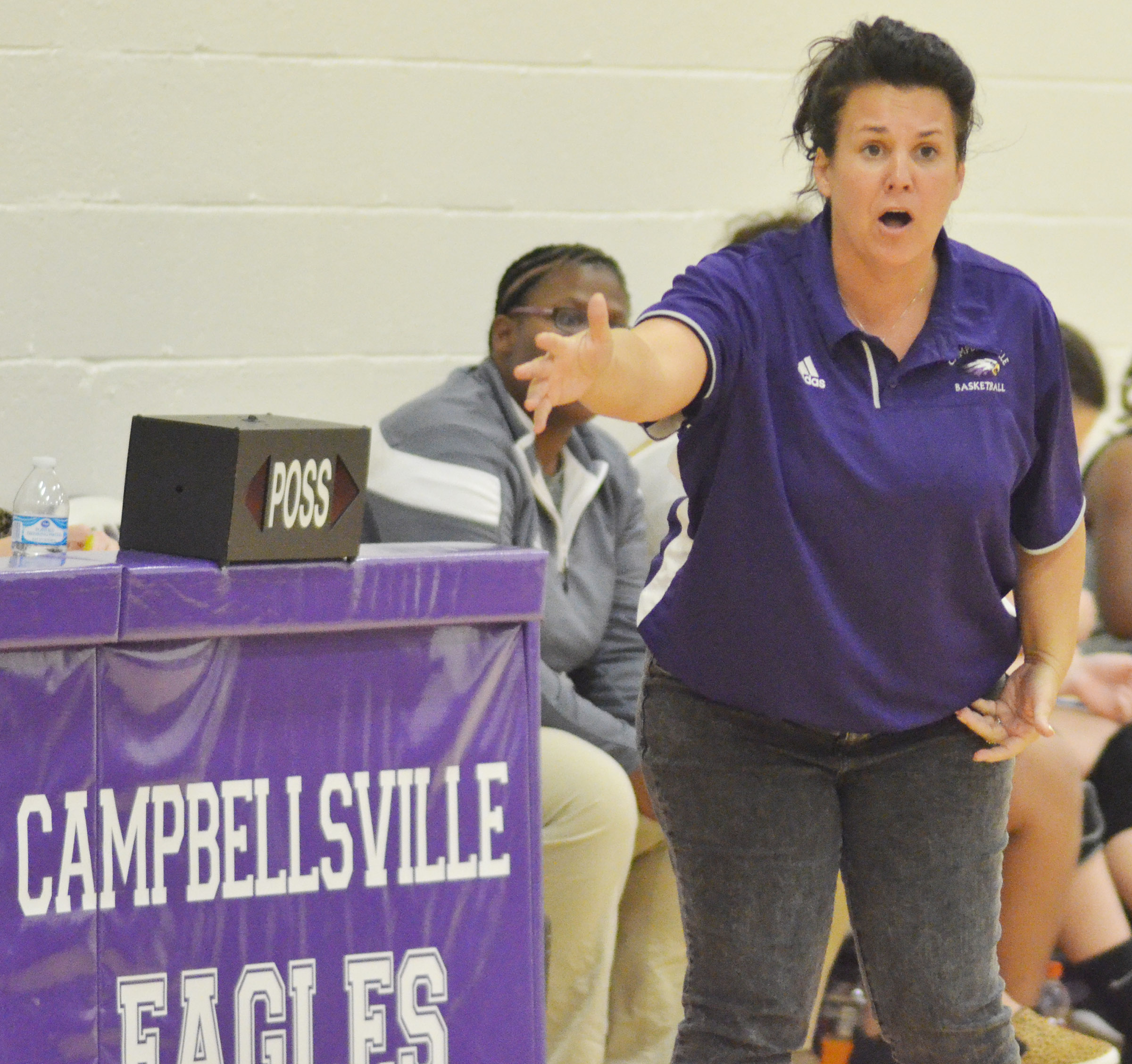 CMS assistant girls' basketball coach Kathy England talks to her players.