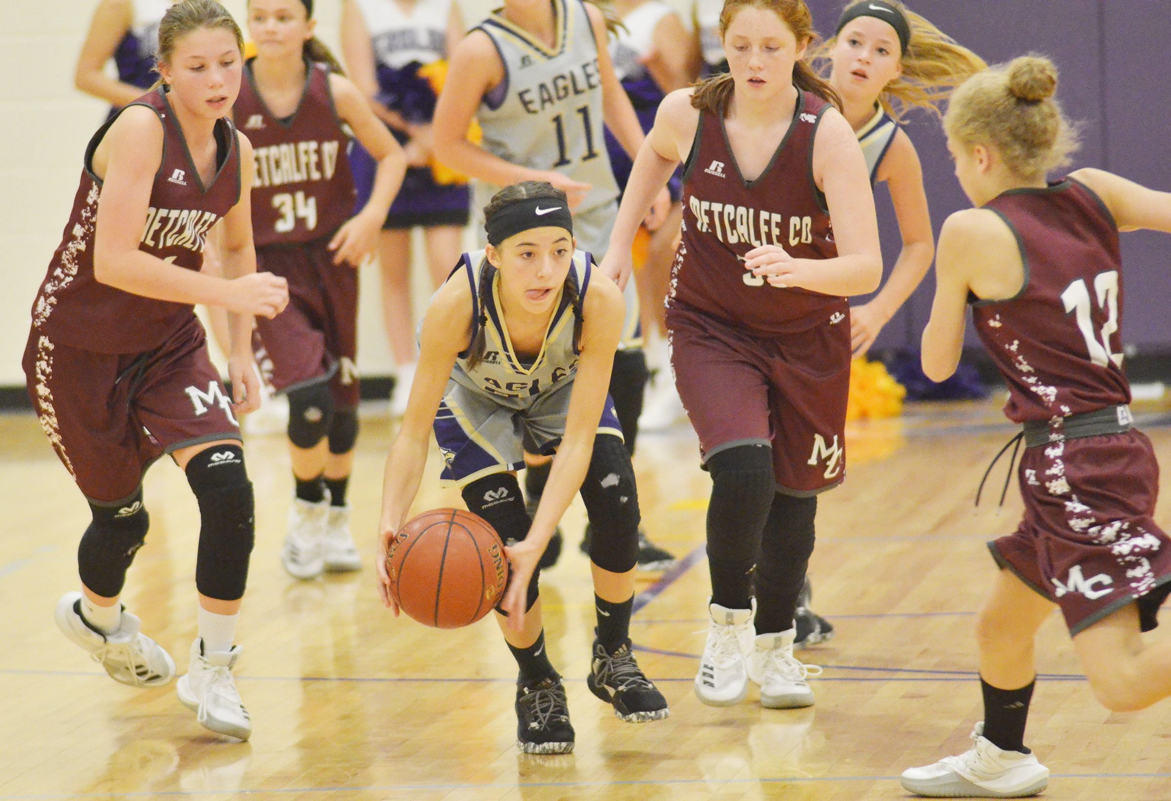 CMS eighth-grader Kaylyn Smith fights for the ball.