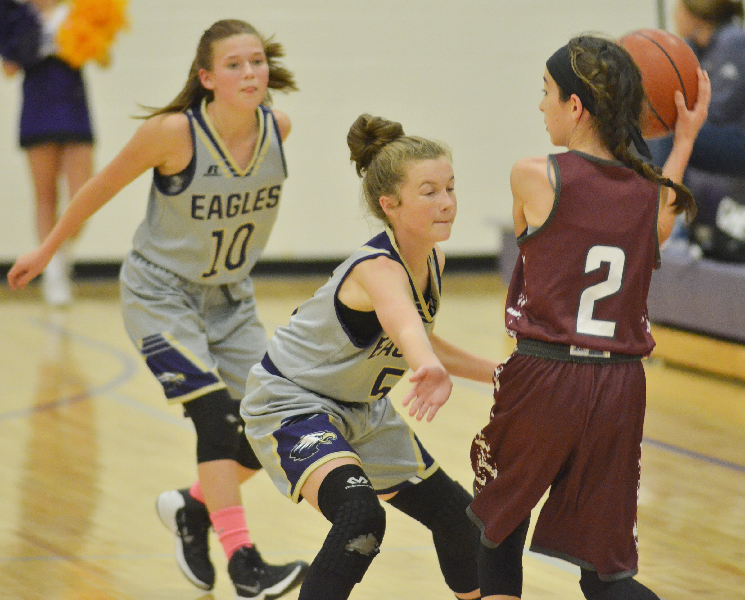 CMS seventh-graders BreAnna Humphress, at left, and Dakota Slone play defense.