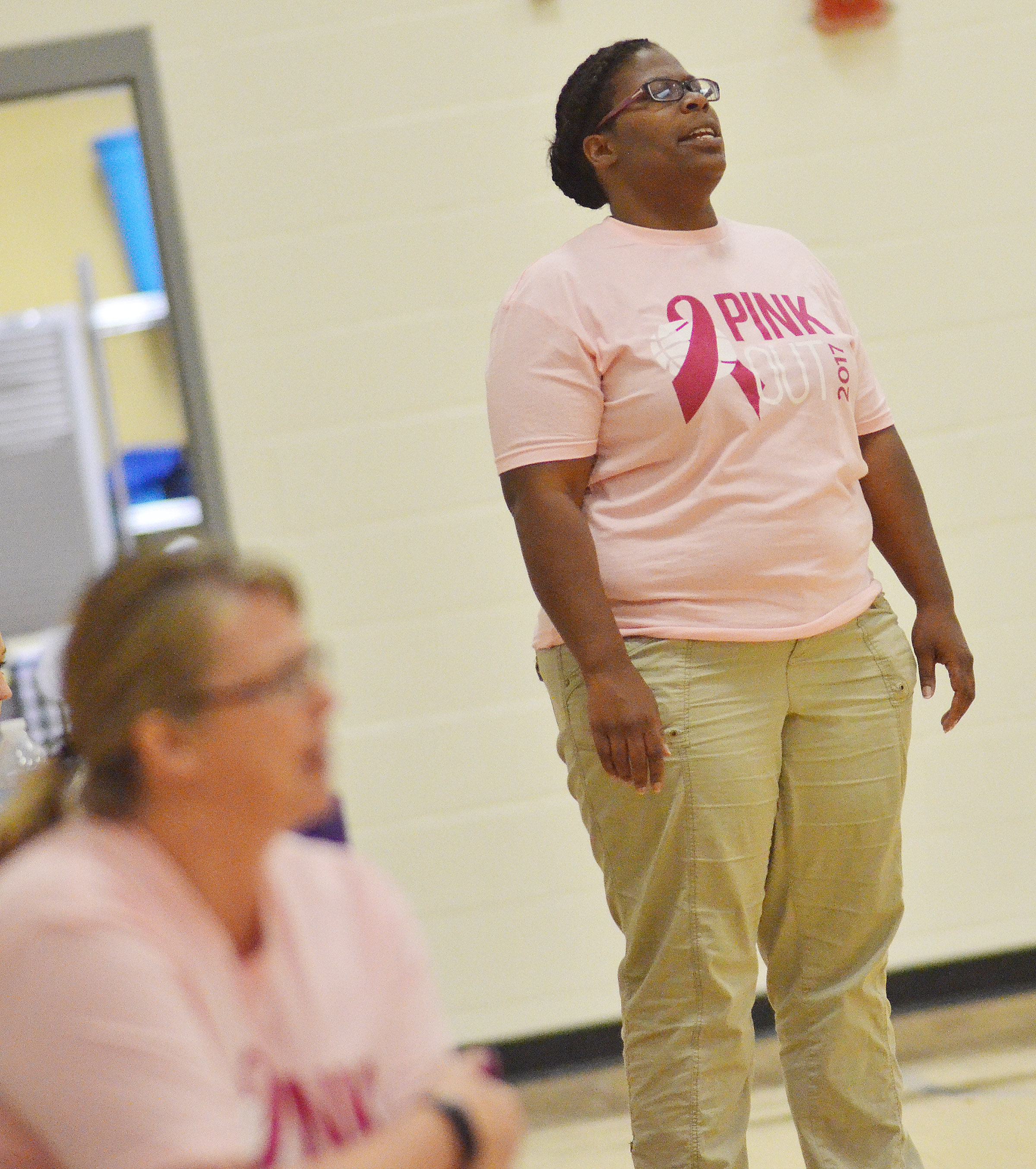 CMS head girls' basketball coach Tiarra Cecil watches her players.