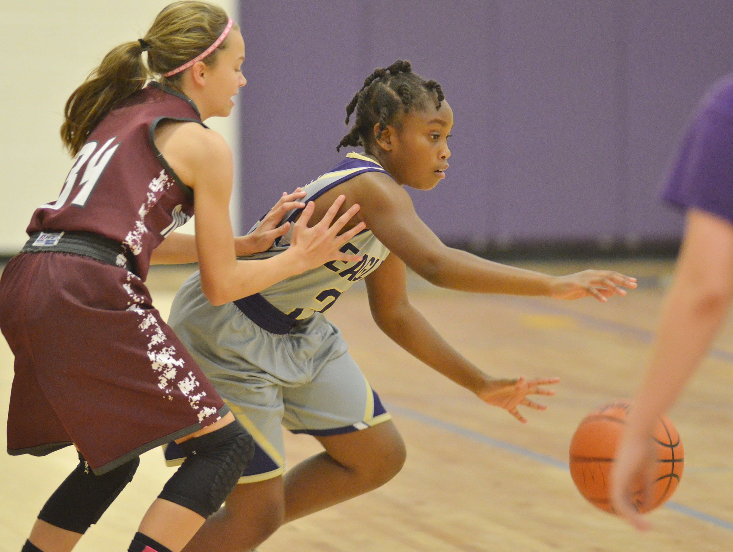 Campbellsville Elementary School fifth-grader Ta'Zaria Owens battles for the ball.