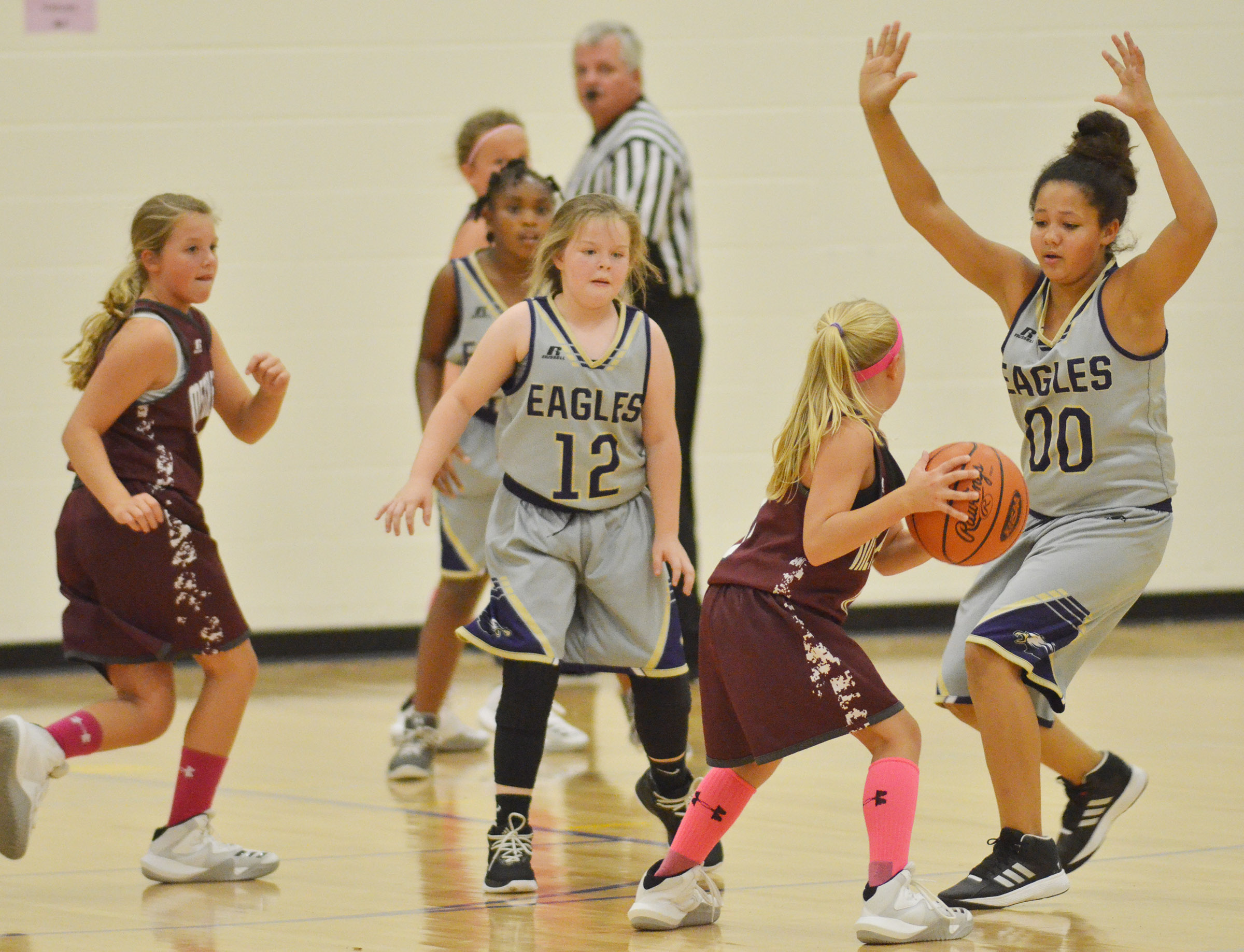 From left, Campbellsville Elementary School fifth-graders Ta'Zaria Owens, Miley Hash and Kenya Bridgewater play defense.